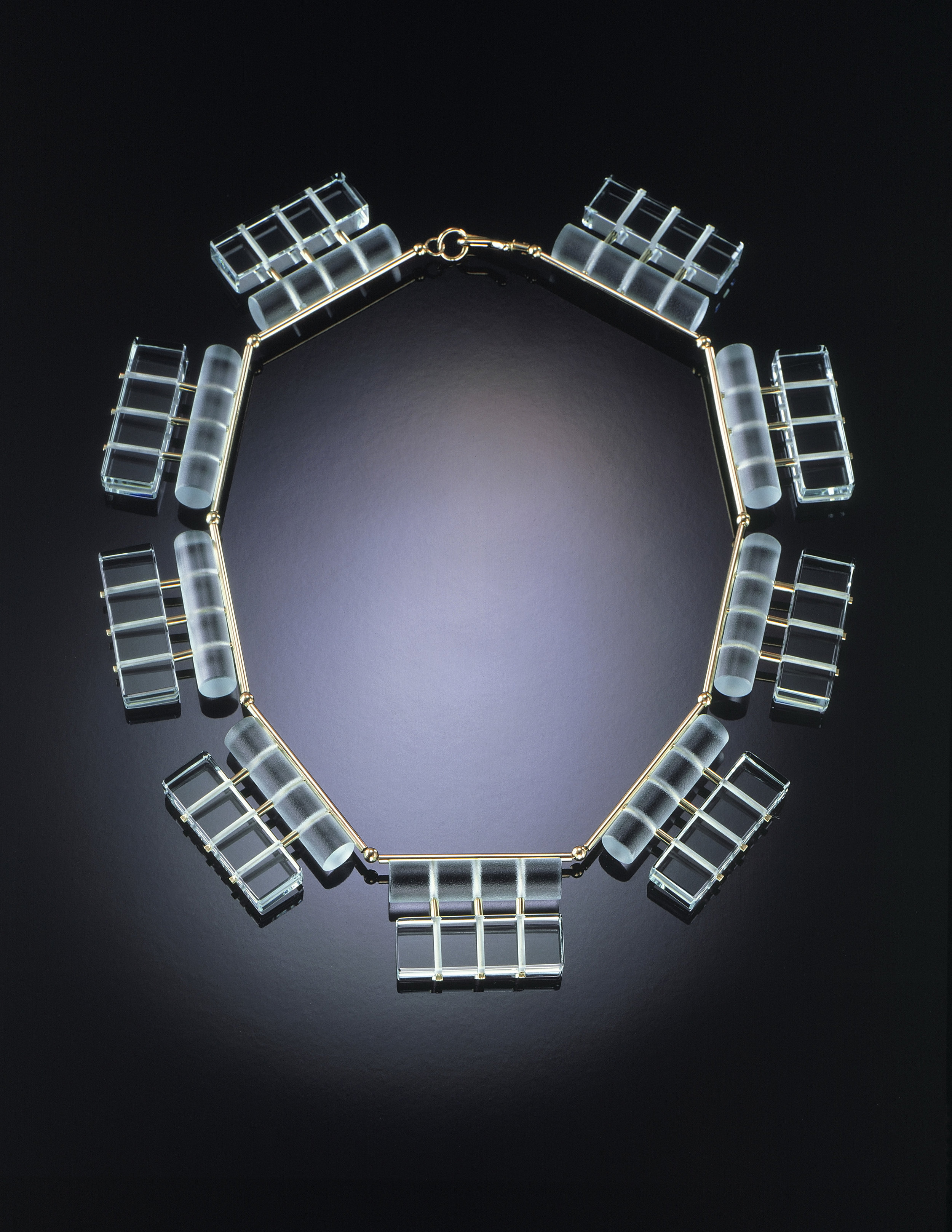 "Linda MacNeil (American, born 1954). Necklace No. 4  from ""Lucent Lines"" series, 1984. Plate glass and 14k yellow gold; 20 1/2 x 7/8 x 1/4 in. Collection of Joan and Jay Ochroch. Photo by Susie Cushner."