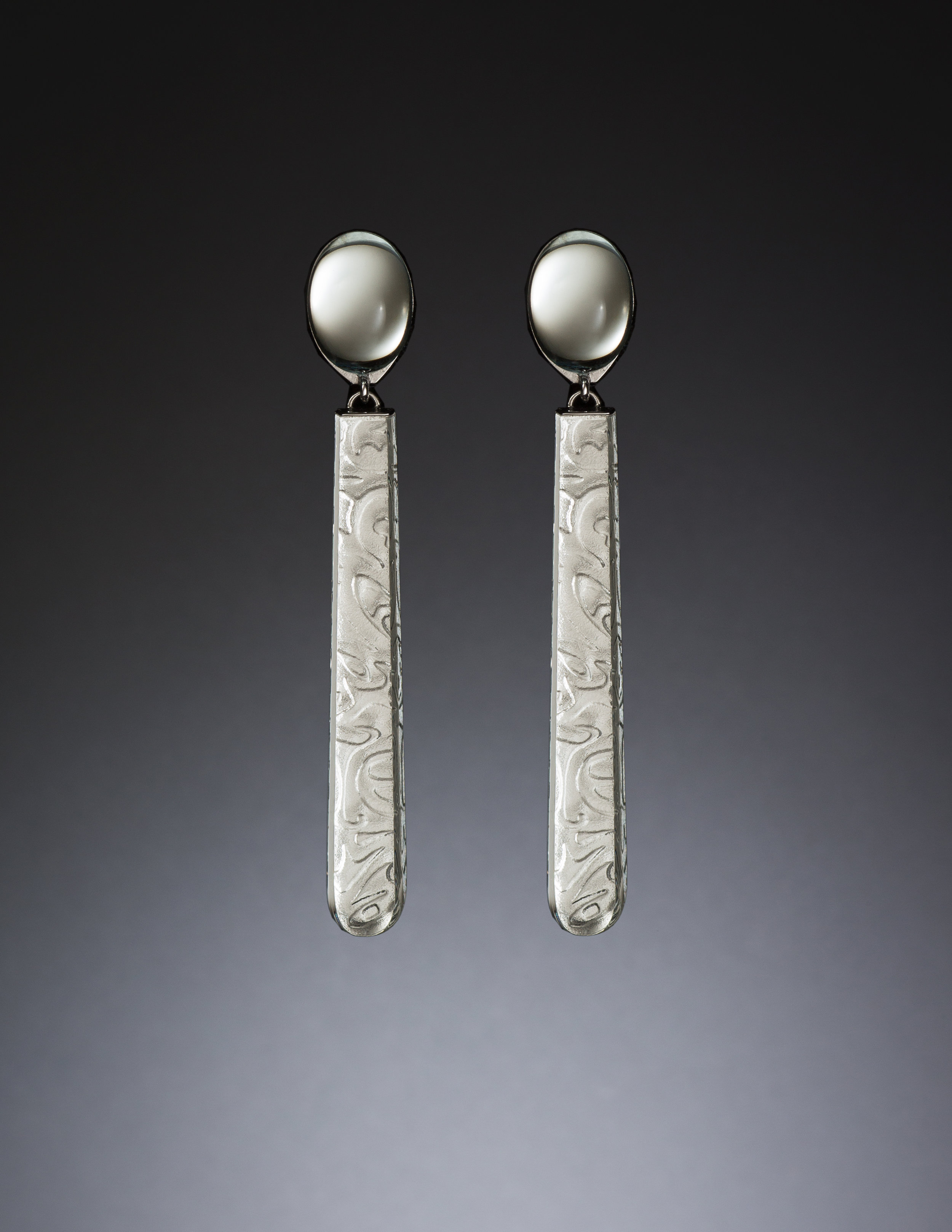 Mirrored Earrings No. 15,  2015. Linda MacNeil (American, born 1954). Plate glass, mirror, and rhodium-plated 14k white gold; 2 5/8 x 1/4 x 1/4 in. Courtesy of the artist. Photo by Bill Truslow Photography.