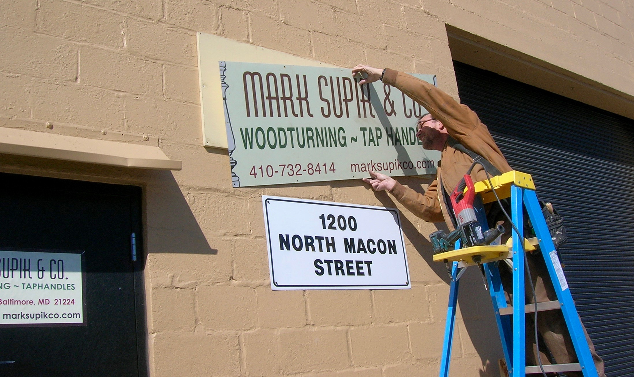 Hanging the Macon St. Sign.jpg