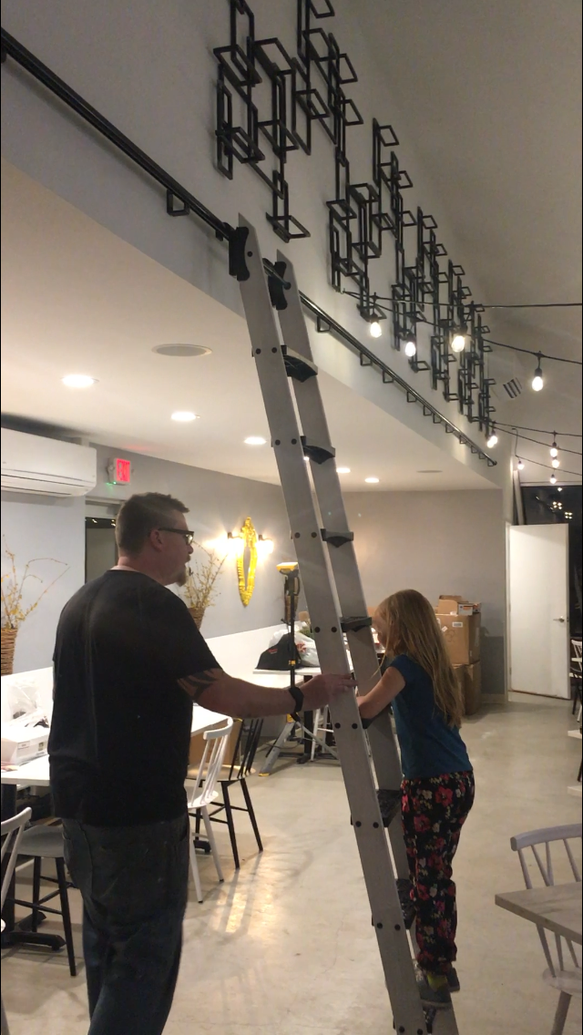 This rolling ladder is one of our favorite features and the kids loved testing it!