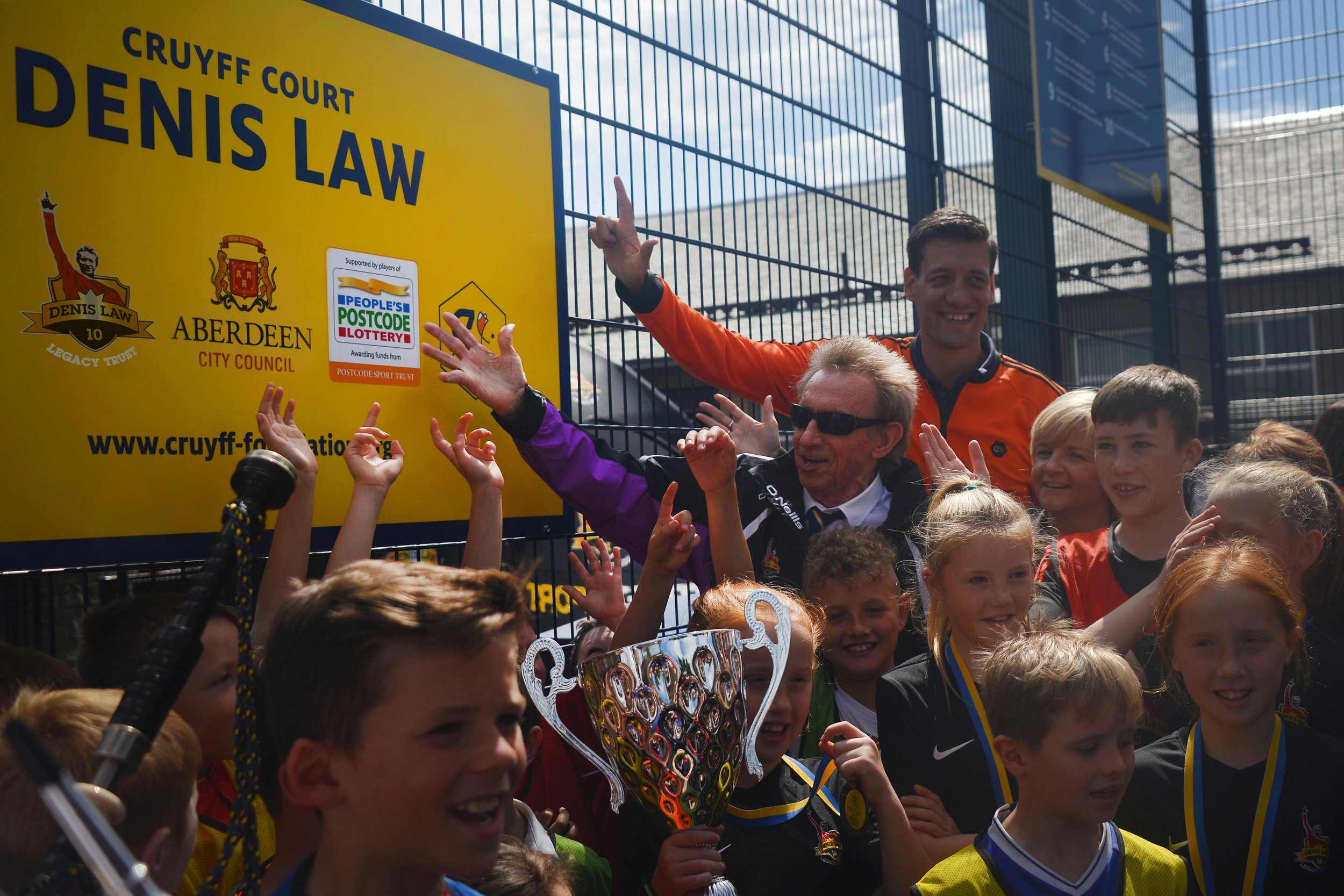 Denis Law and Niels Meijer of the Cruyff Foundation at the first Cruyff Court opening at Catherine Street.