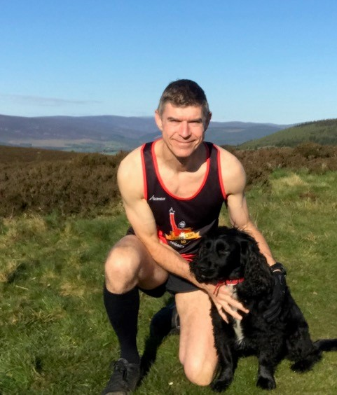 Dave training in his Denis Law Legacy Trust vest with his furry companion.