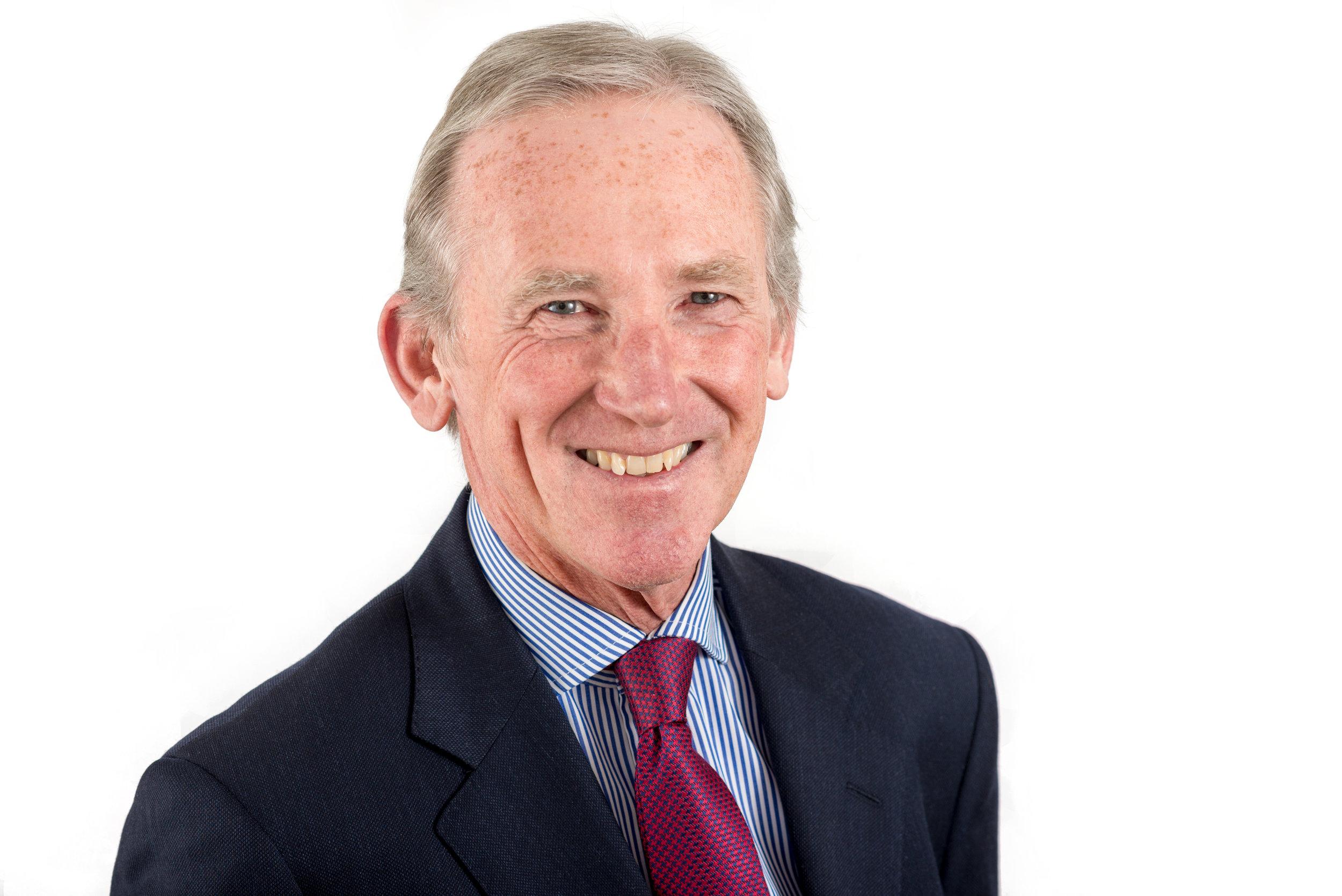Businessman Headshot Photo Wearing blue Jacket and claret tie