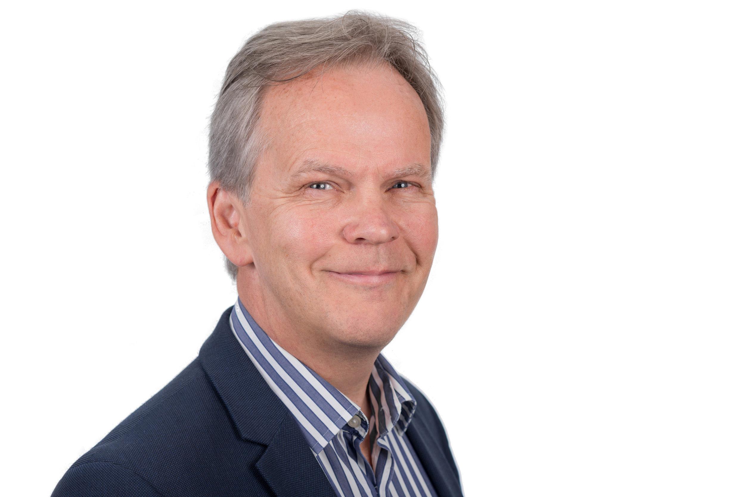 Businessman Headshot Photo Wearing blue Jacket with stripy shirt