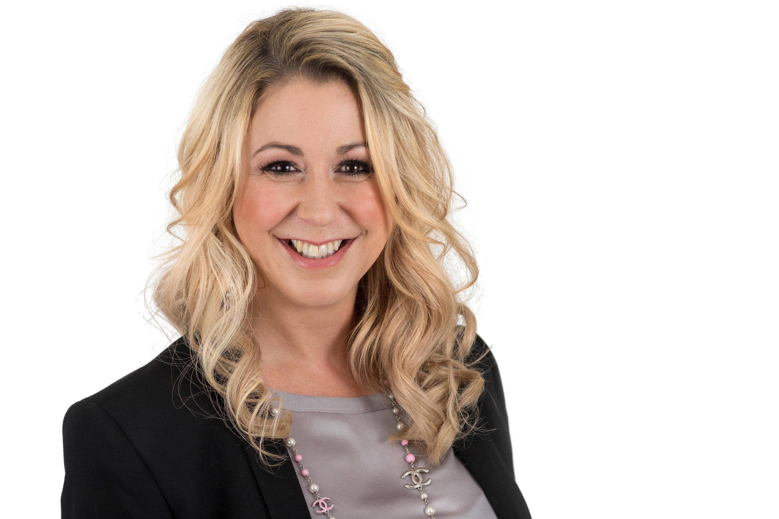 Blonde Businesswoman Headshot Photo Wearing Dark Jacket