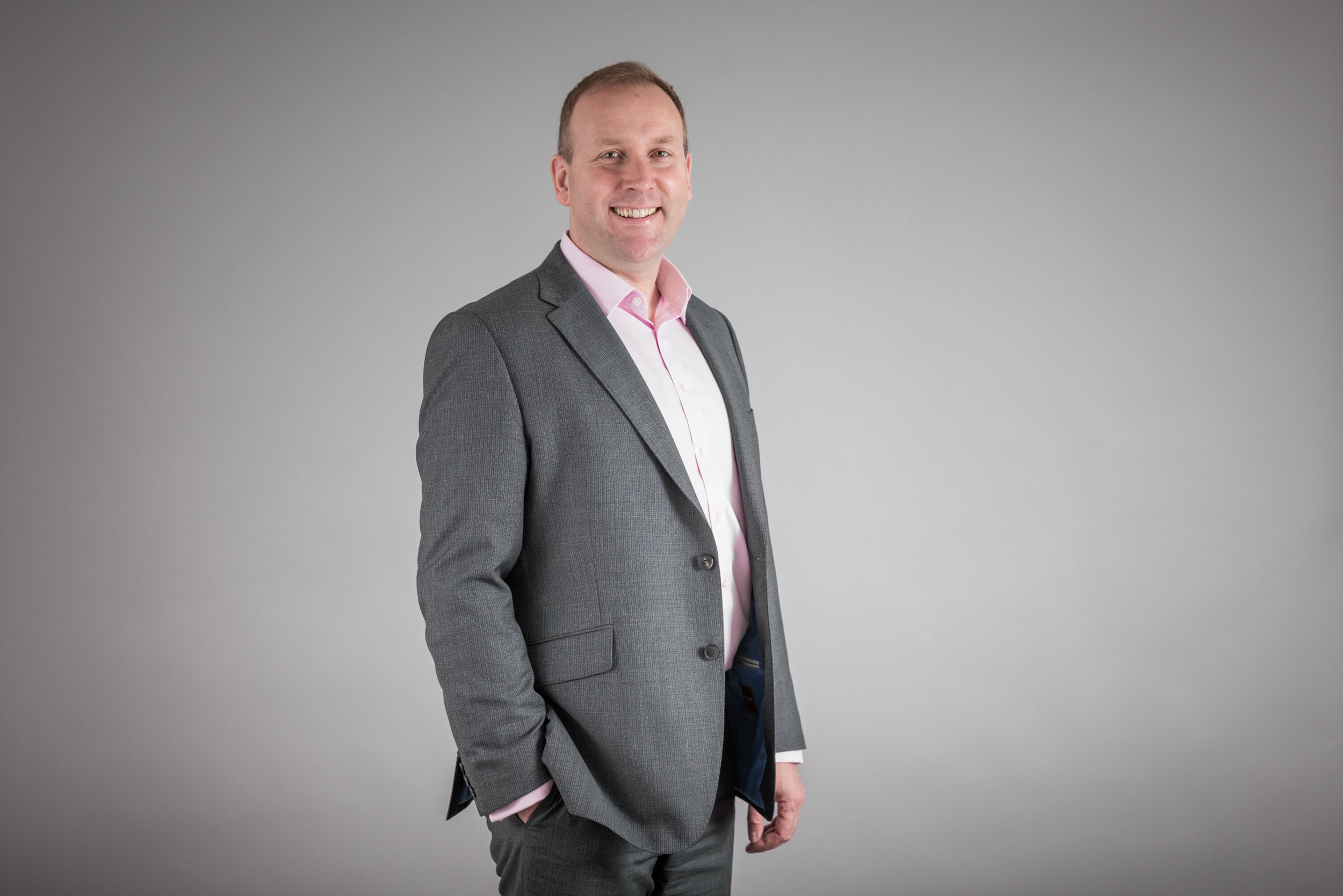 Businessman Portrait Photo Wearing grey Jacket and pink shirt