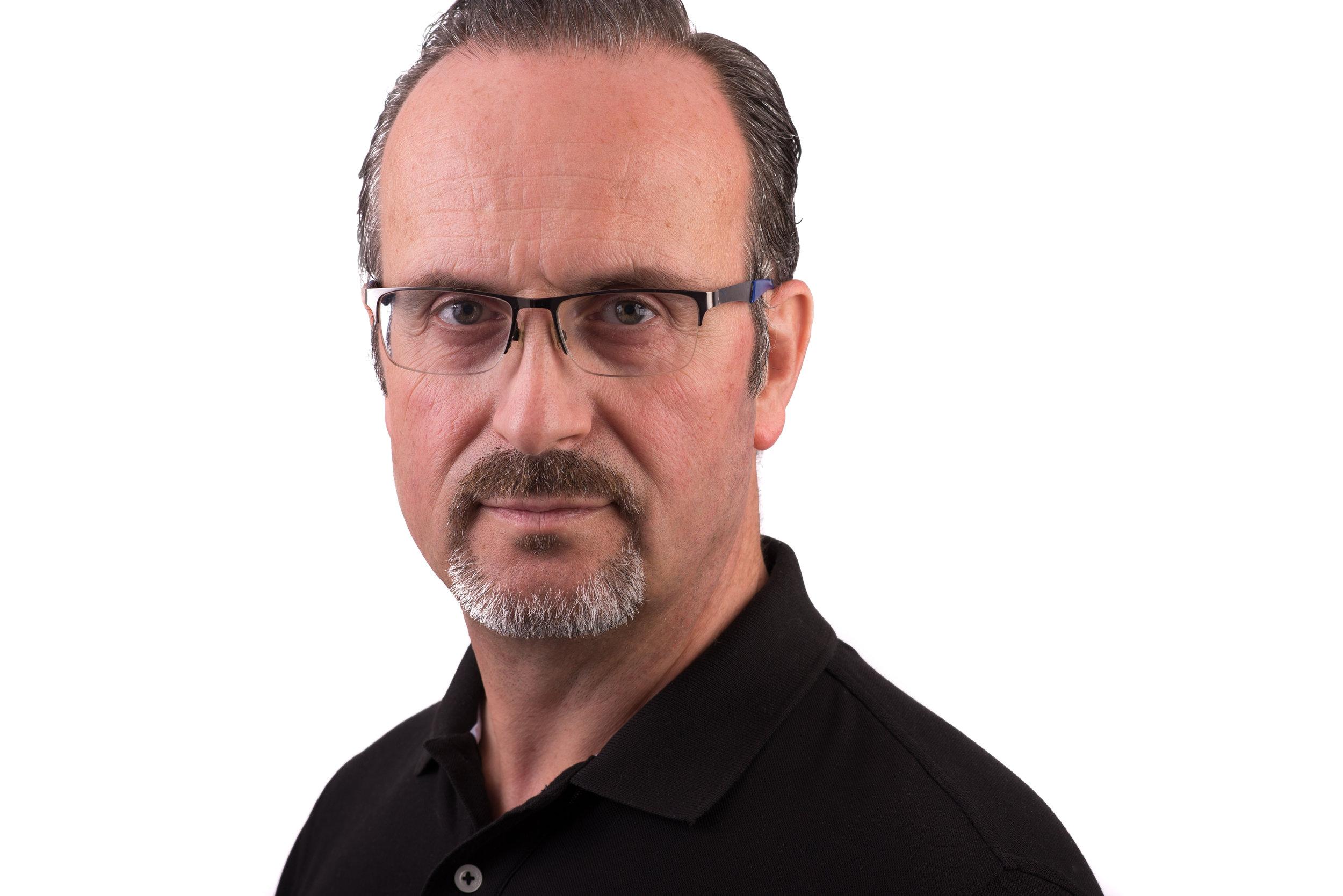 Businessman Headshot Photo Wearing black polo