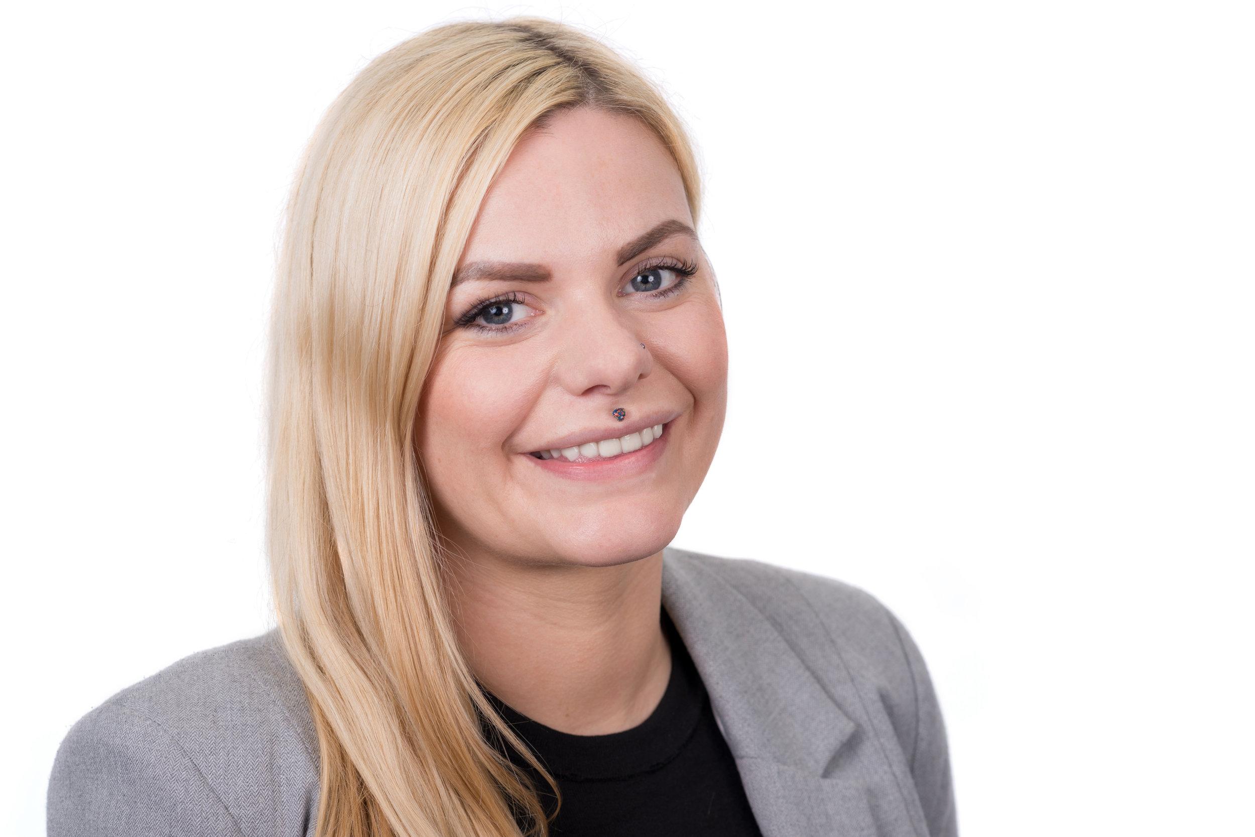 Blonde Businesswoman Headshot Photo Wearing Light Jacket