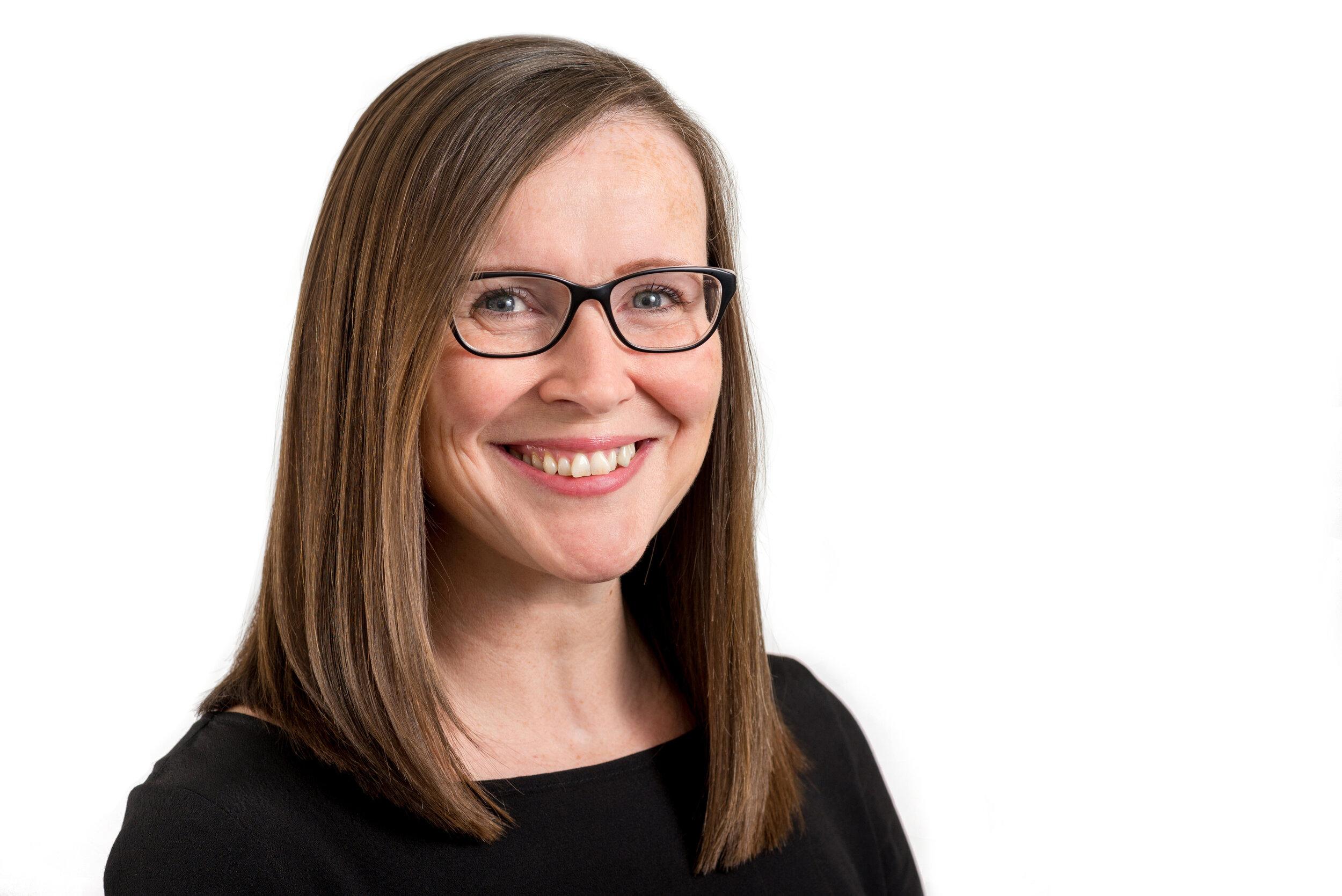Brunette Businesswoman Headshot Photo Wearing dark top