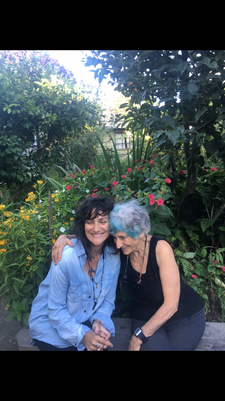 andree and janeen in garden.PNG
