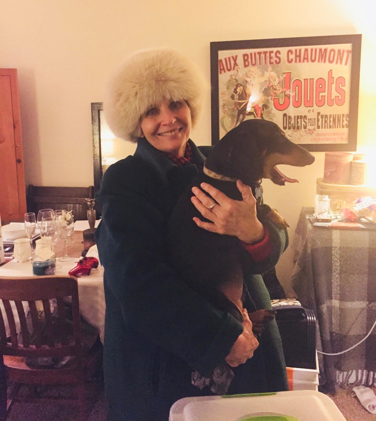 This is my favorite picture of Grams. She is holding a dachshund and wearing a giant fuzzy hat. I could make a tiny home in that hat and live forever in happiness. Take a look behind the star of the show, Gram Bam. Notice the chaos. Piles of junk all over. A freezer in our living room covered by a blanket Y'all, it was a time.