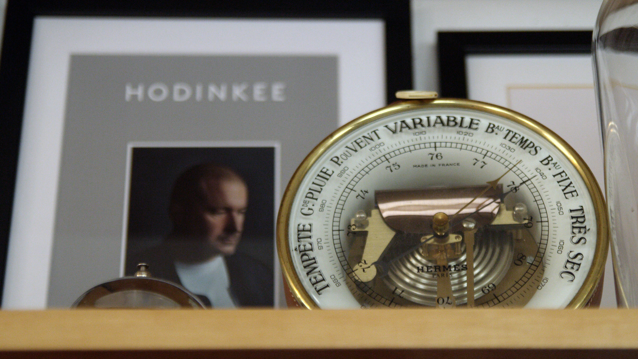Hodinkee Magazine Vol. 2 (yes, that's Jony Ive on the cover) and a Hermès Holosteric barometer.