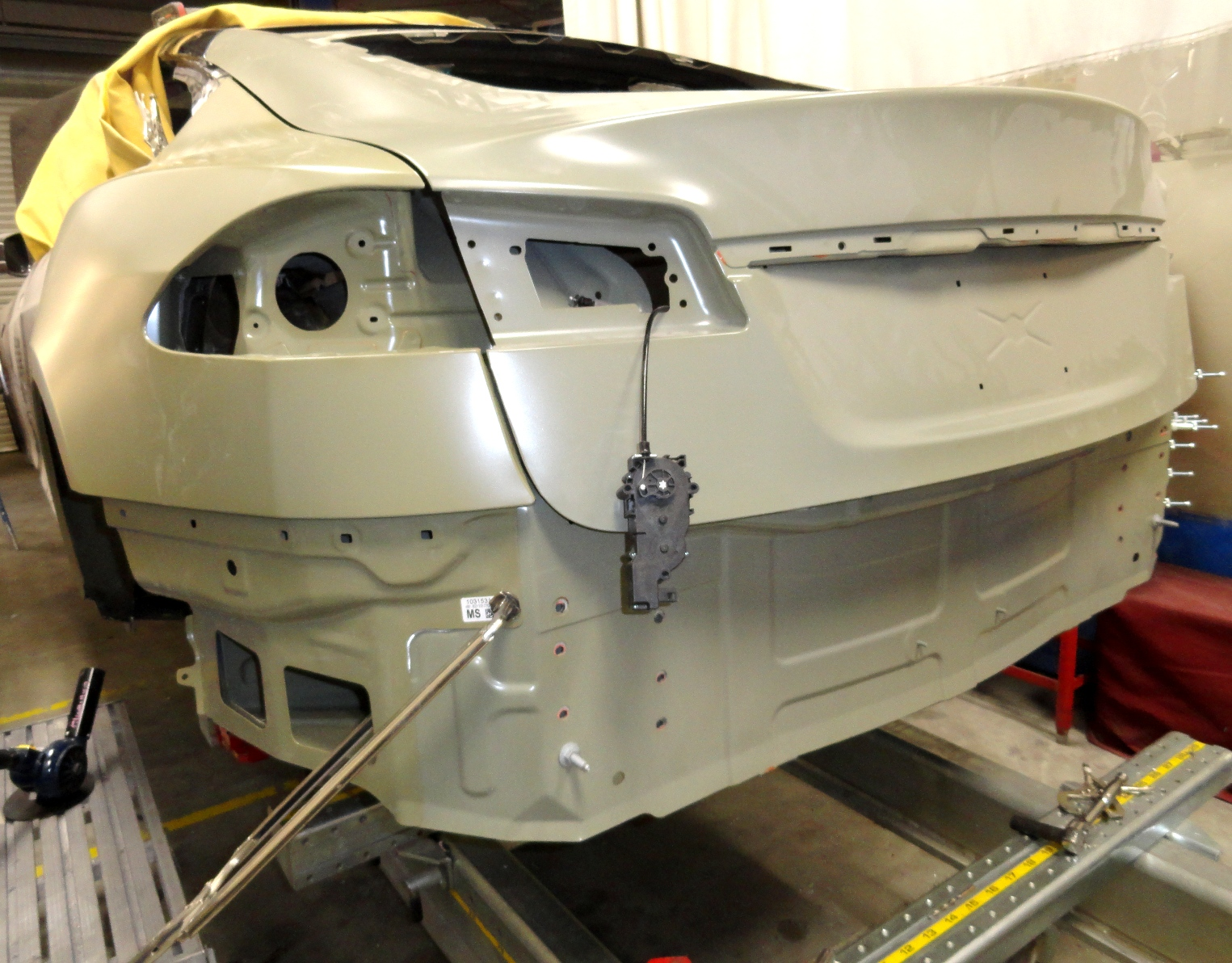 A Tesla Model S that we replaced the Rear Aluminum exterior panels per Tesla guidelines.