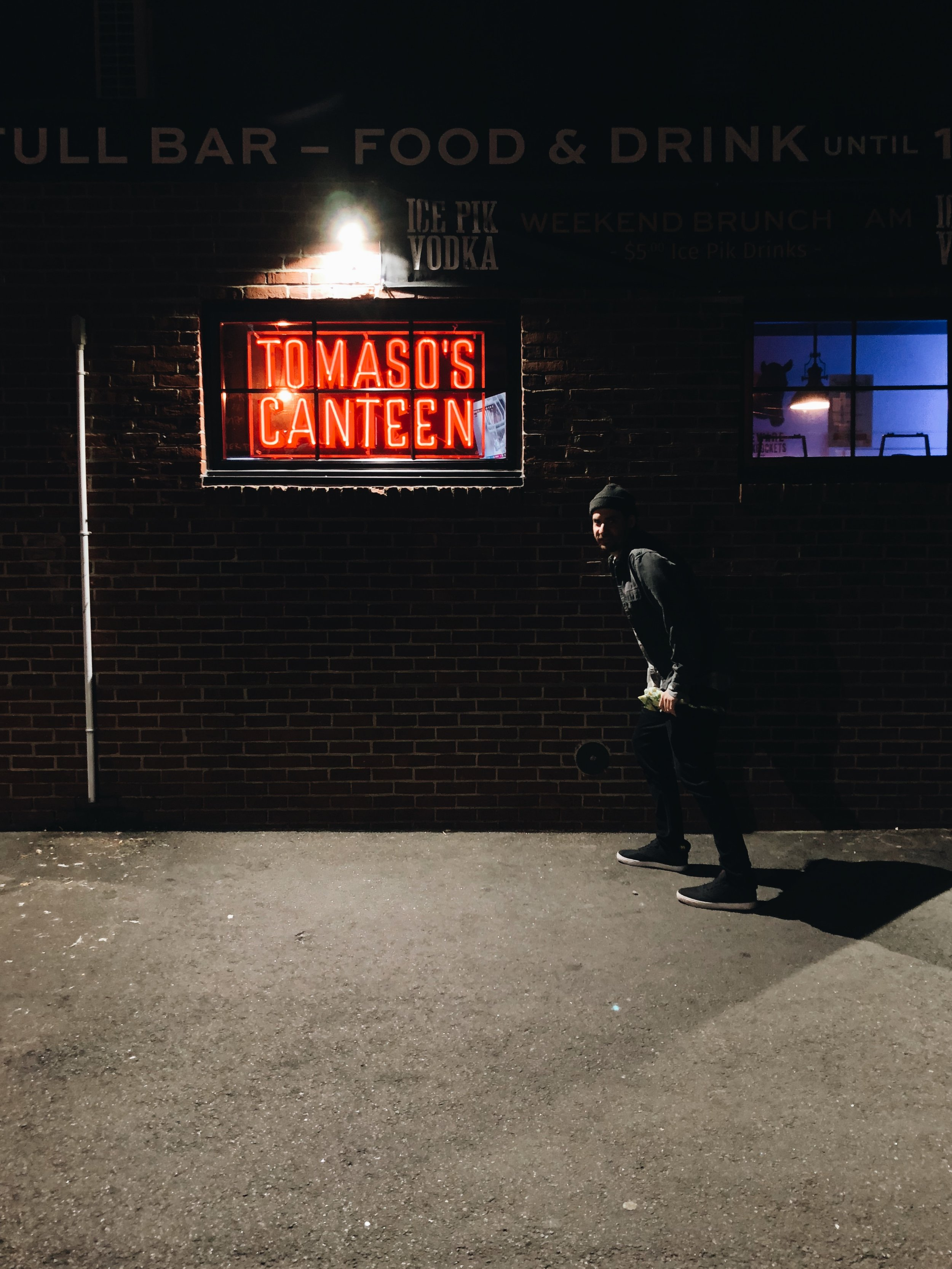 Alex posing in front of Tomaso's - before the Jell-o shot