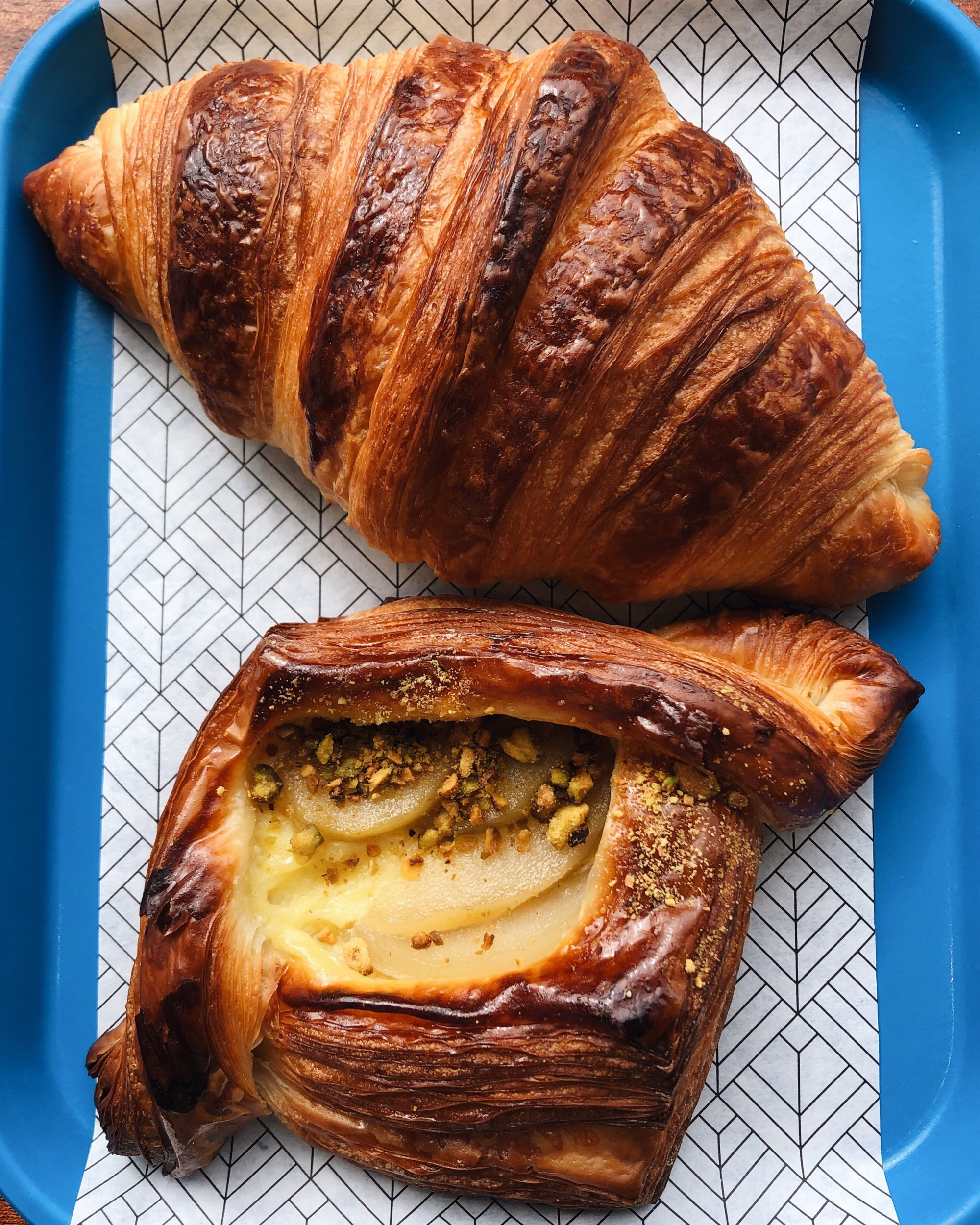 The most perfect croissant and a pear-pistachio danish at Belleville