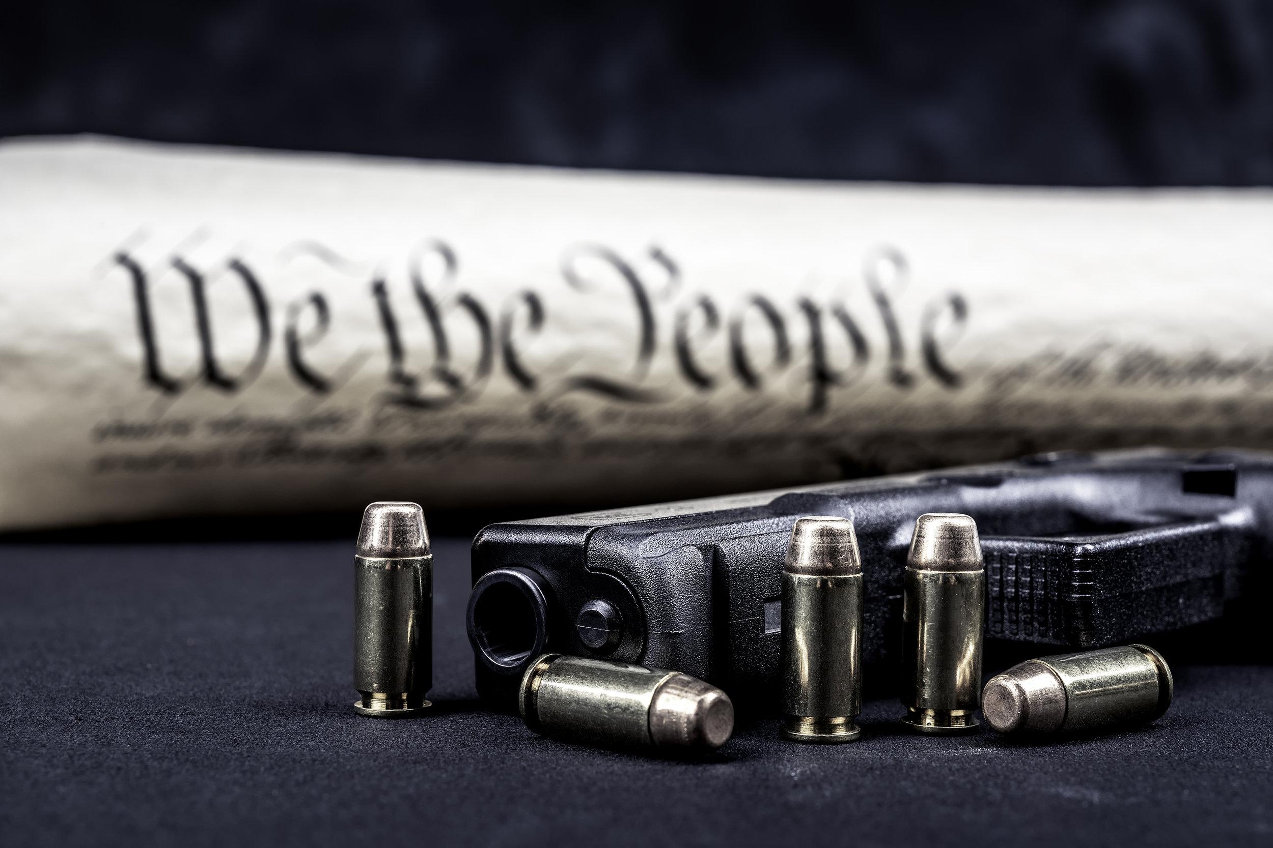 bigstock-A-handgun-with-bullets-symboli-191723428.jpg