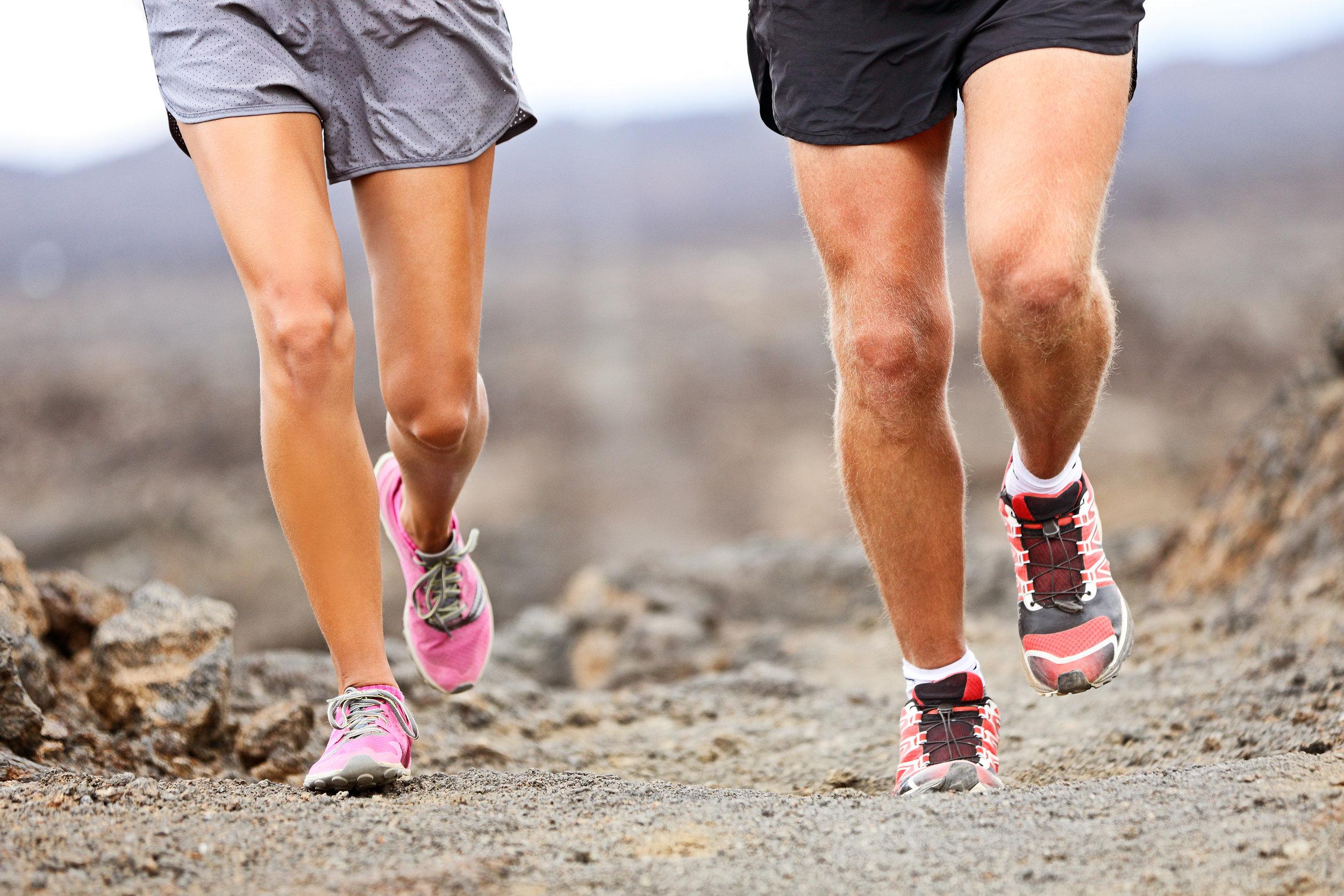 bigstock-Runners-running-shoes-on-trail-227561632.jpg