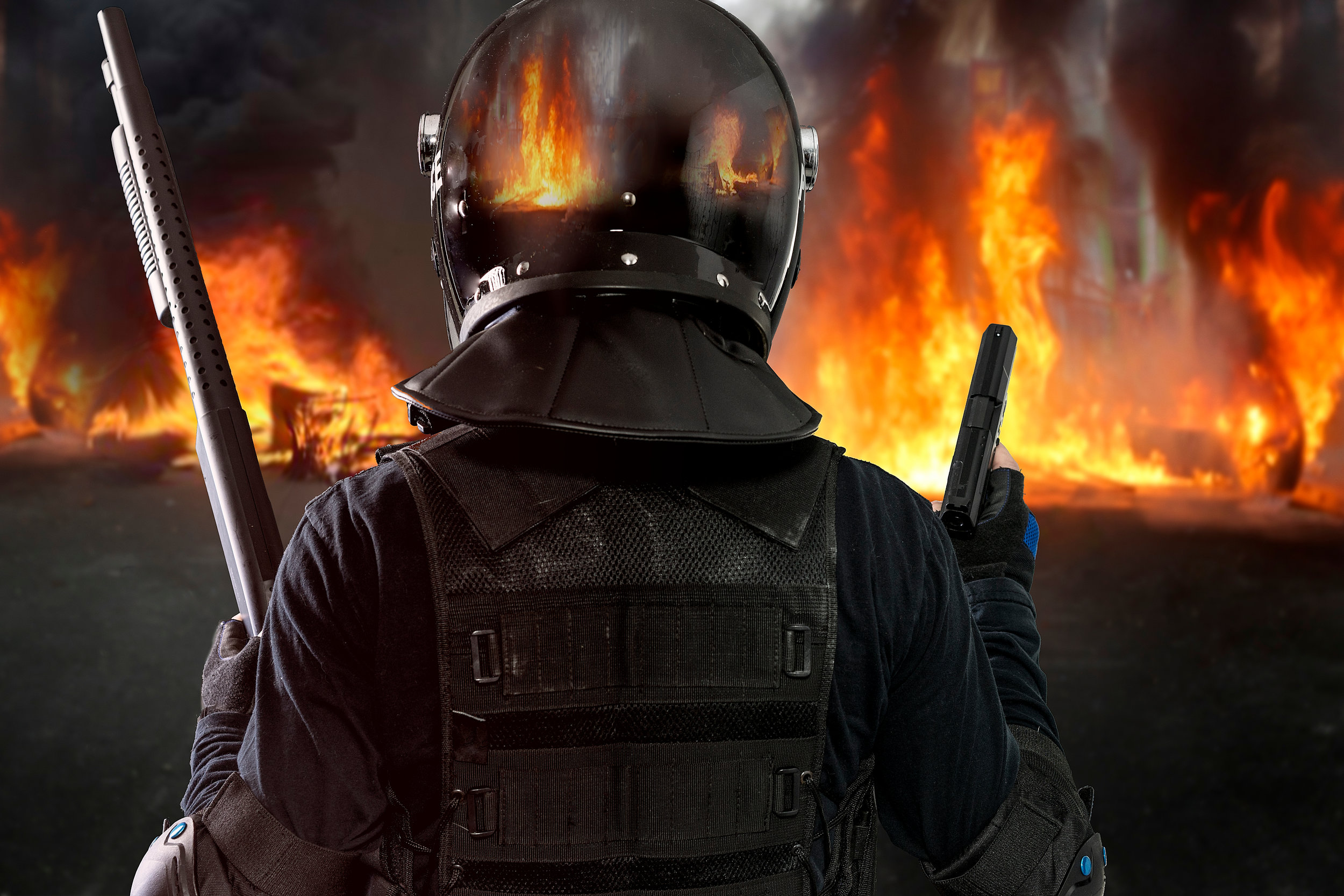 bigstock-Burning-barricades-policeman--239370325.jpg