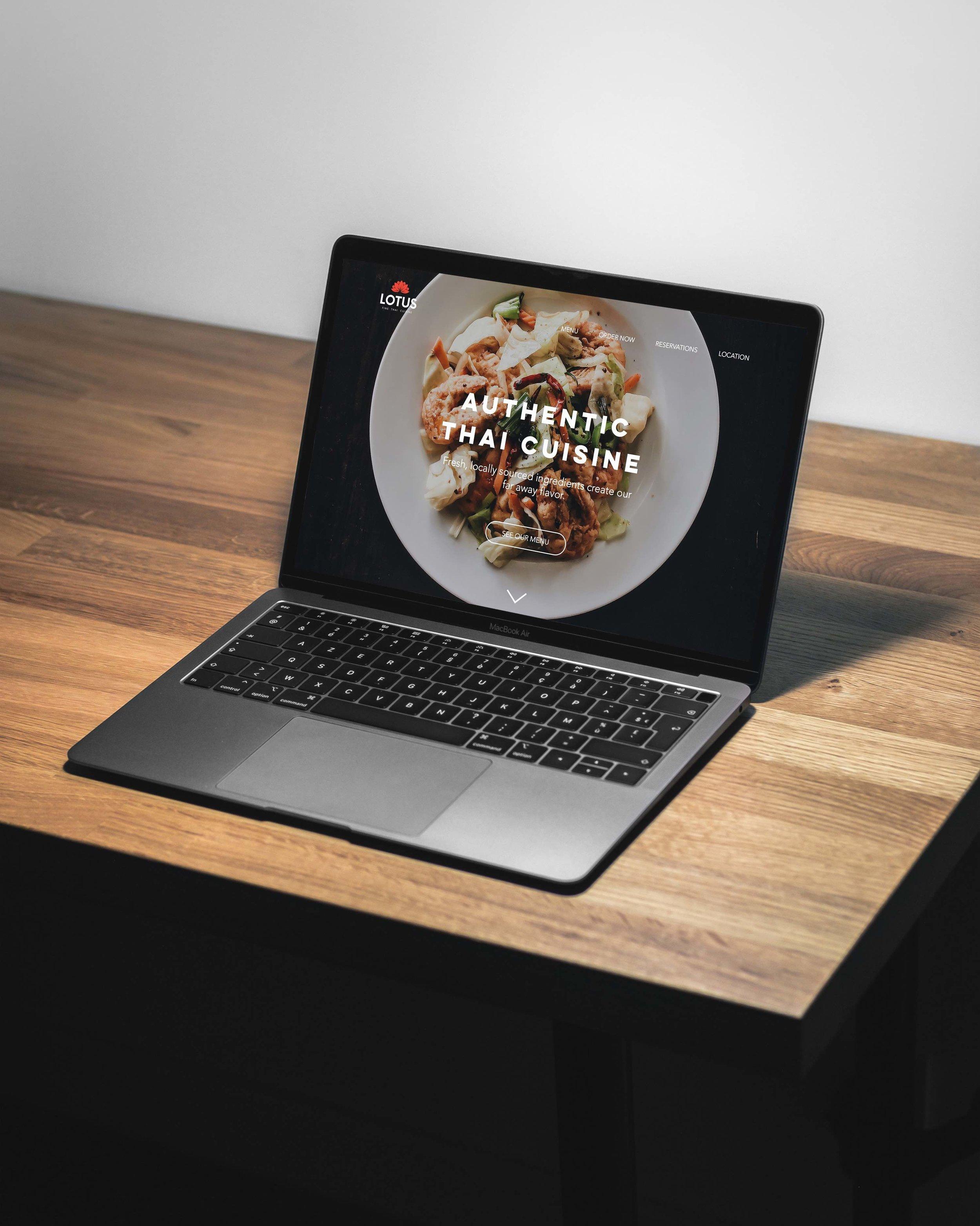 Lotus Website displayed on a MacBook