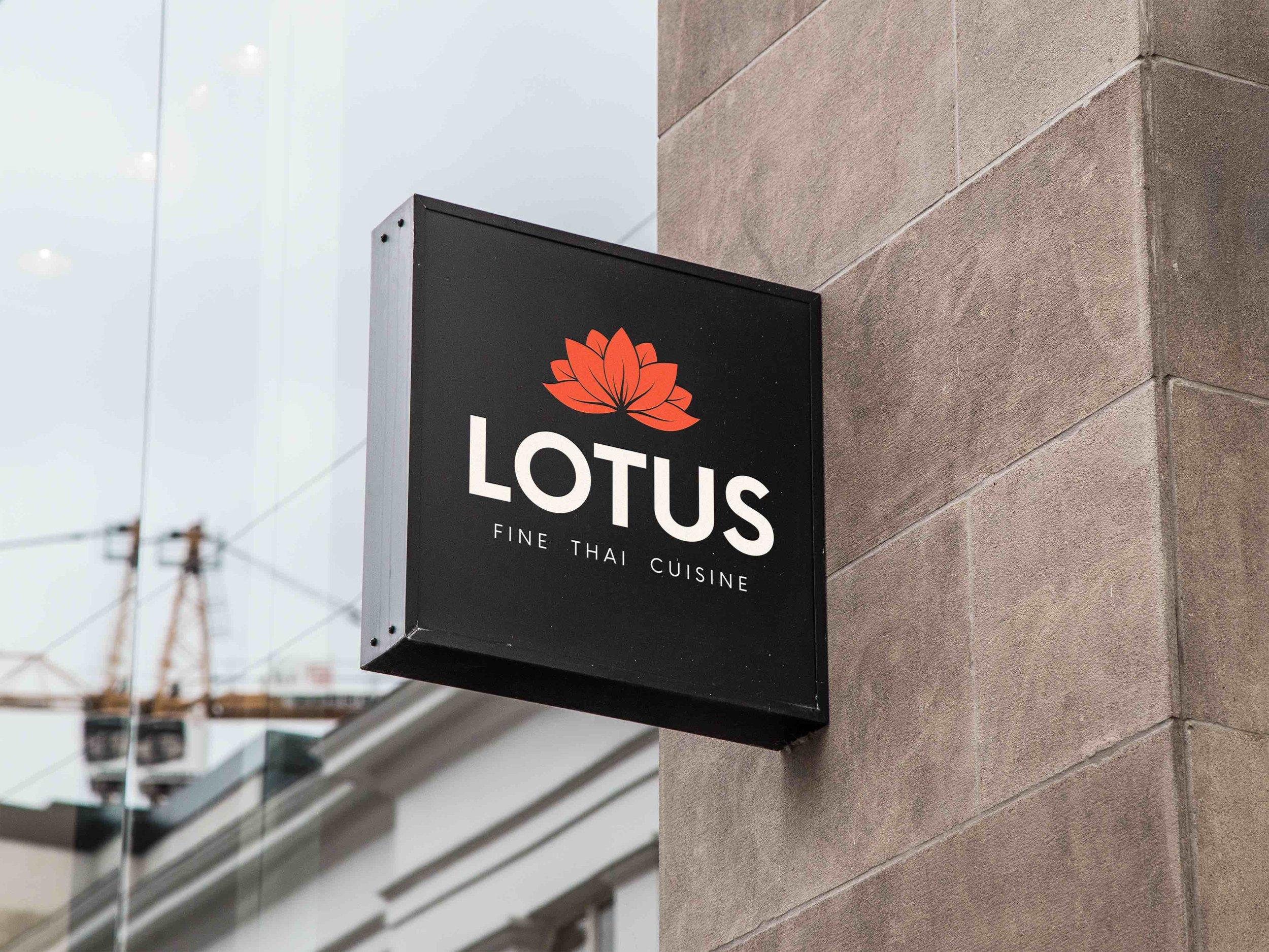 Lotus Sign hanging outside of restaurant