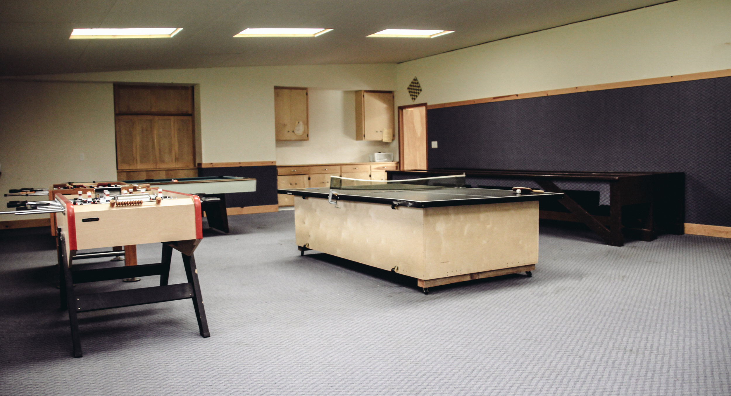 Our Game Room with Ping Pong, Carpet Ball, Foosball and Pool!