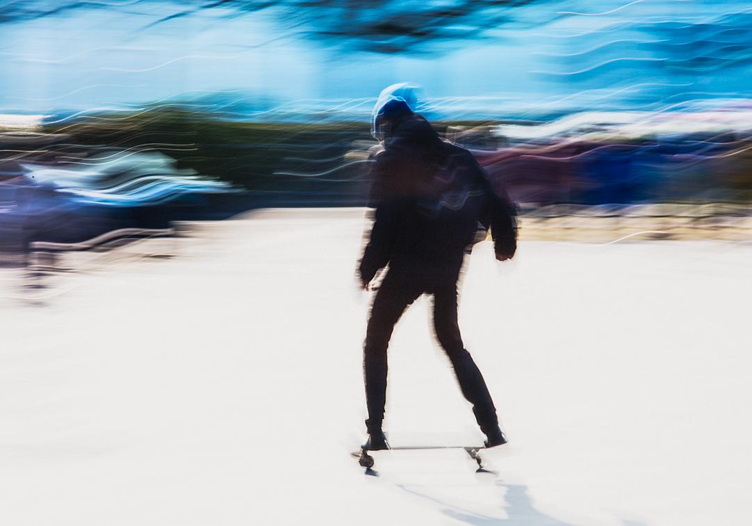 Skateboarding in front of Zurich Opera House.