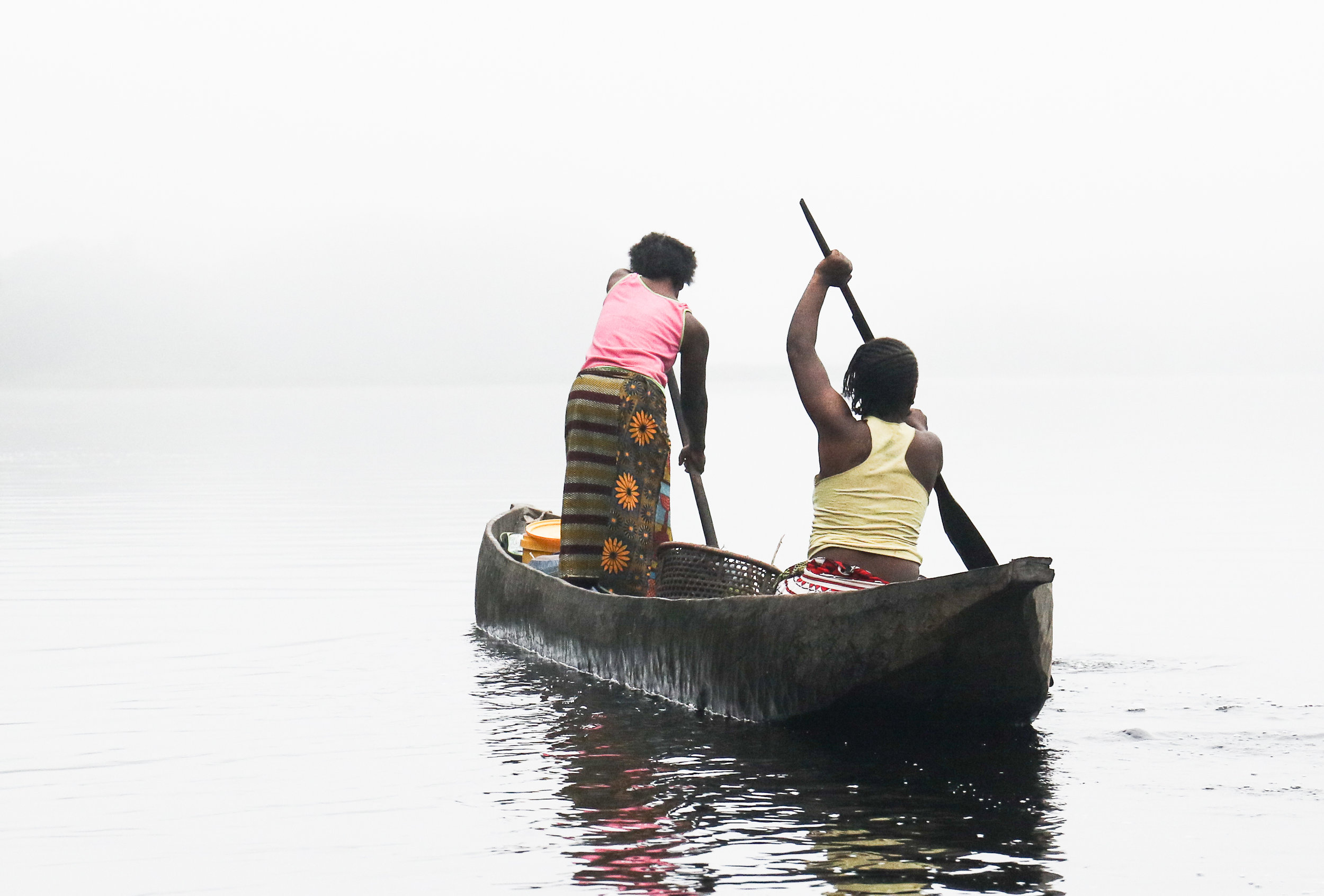 Two women fishing at dawn on the Lopori River in Equateur Province, DRC