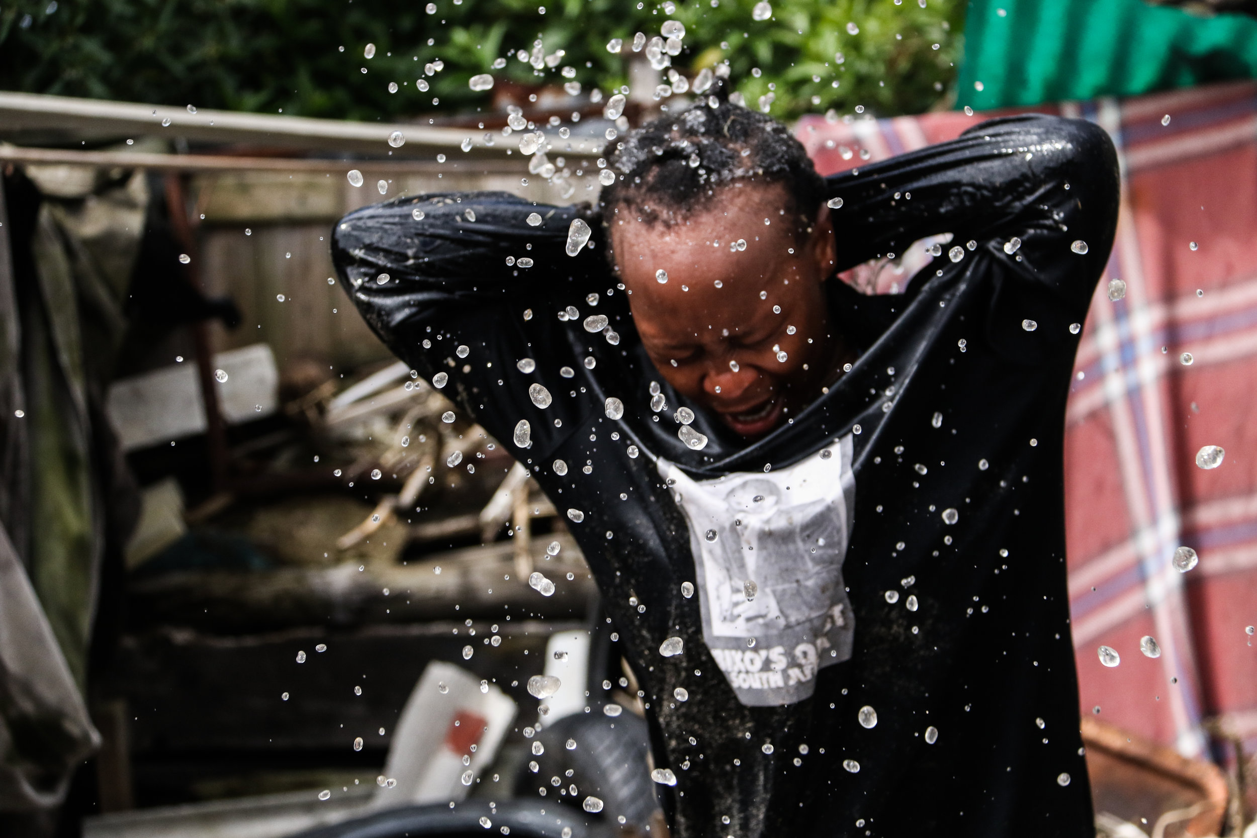 Vathiswa Nodlayiya,a performance artist, rehearses in a backyard in the township of Langa, Cape Town, South Africa