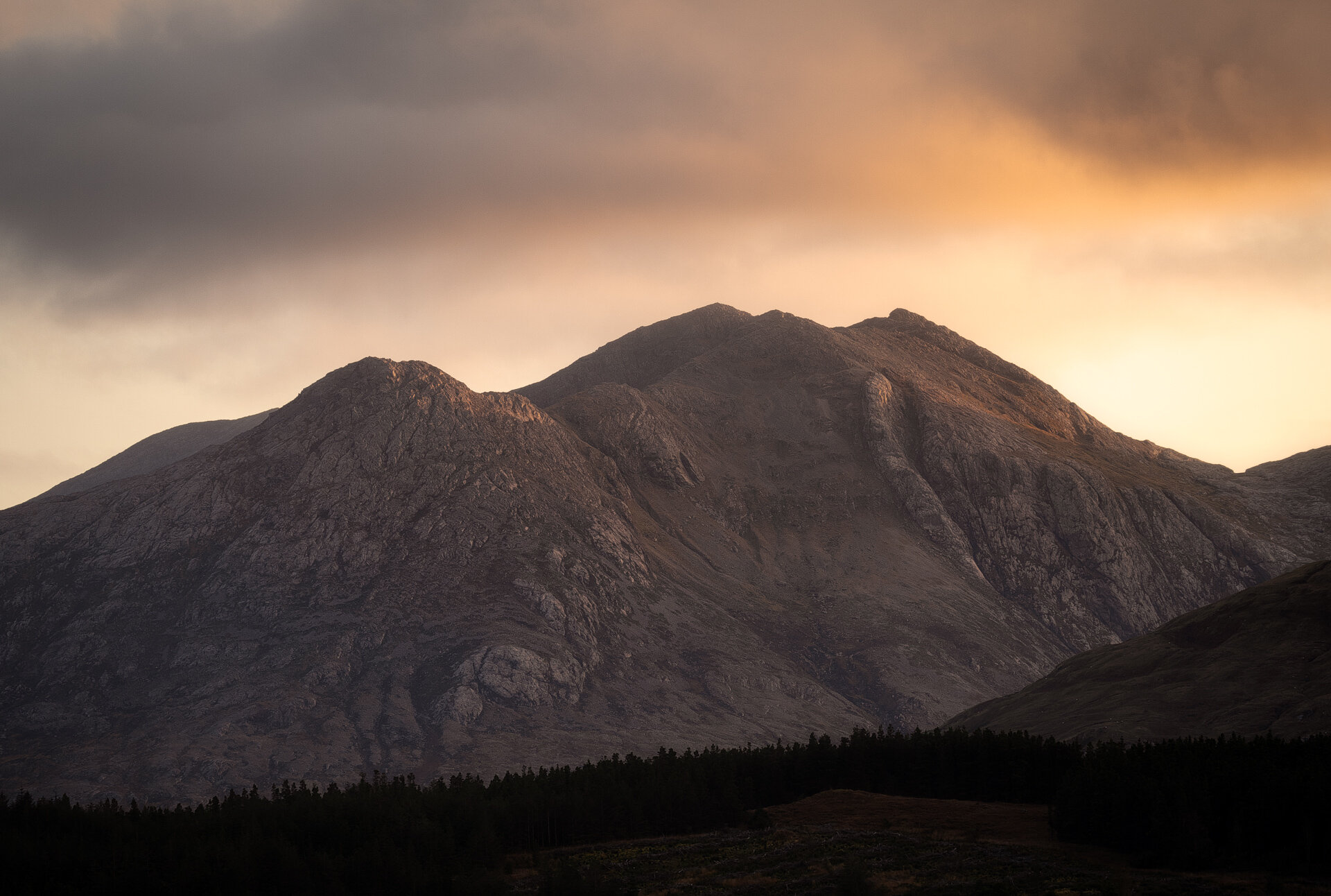 Golden light hitting the peaks of mountains in the west of Ireland. This was shot handheld at 100mm. Tack sharp! See below for the wide angle shot of this scene.