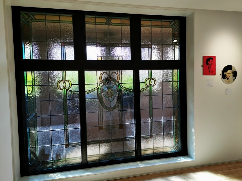 Craig Donald 's work alongside restored windows from the Orpheus building in the Sea Holly Gallery