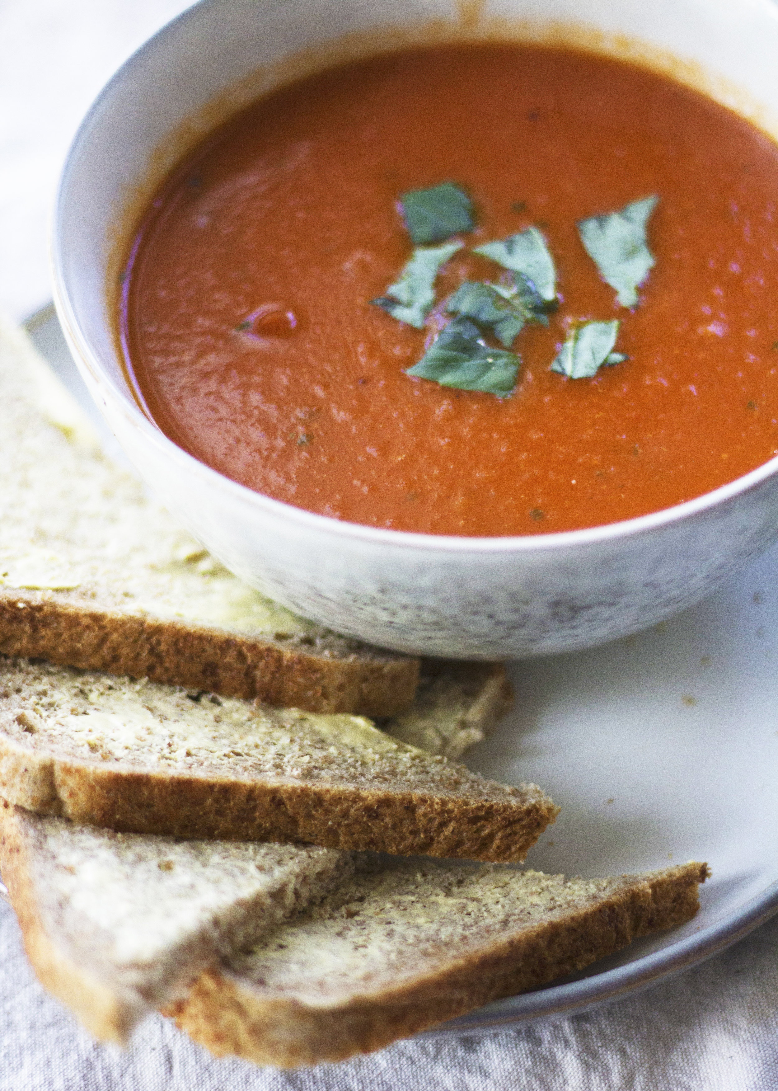 This hearty tomato soup will hit all the right spots on a sick or rainy day. - prep time5 mins  total time20 mins  serves 4