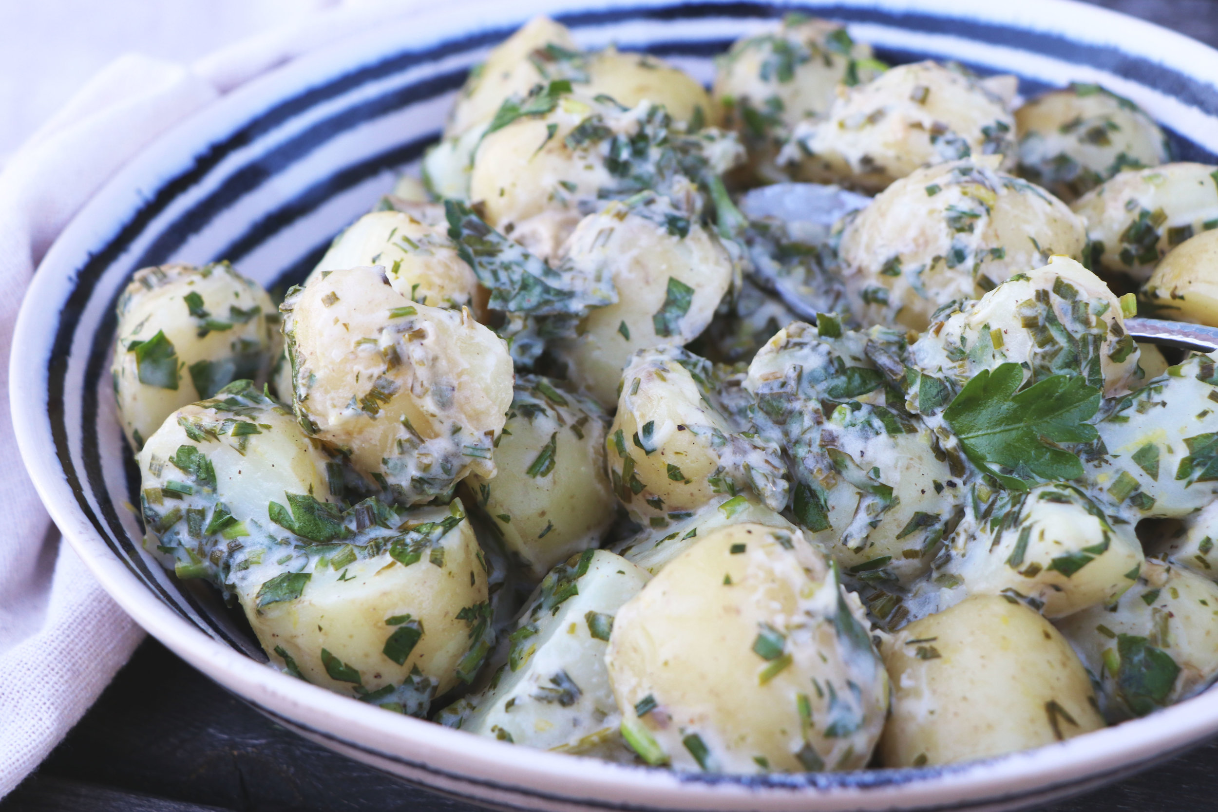 This fresh and easy potato salad will become a staple for your summer BBQs and dinner parties. - prep time 15 mins    total time 20 mins     serves 4-6