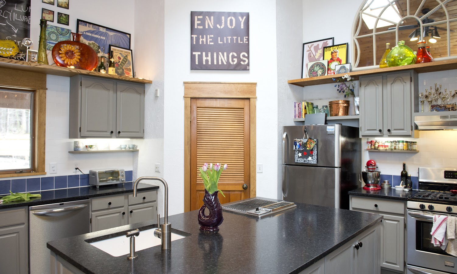 This upcycled kitchen uses a combination of all things sustainable, from updating the existing cabinetry, and salvaging the grill in the island, to bringing in high quality plumbing and tiles made from recycled materials.
