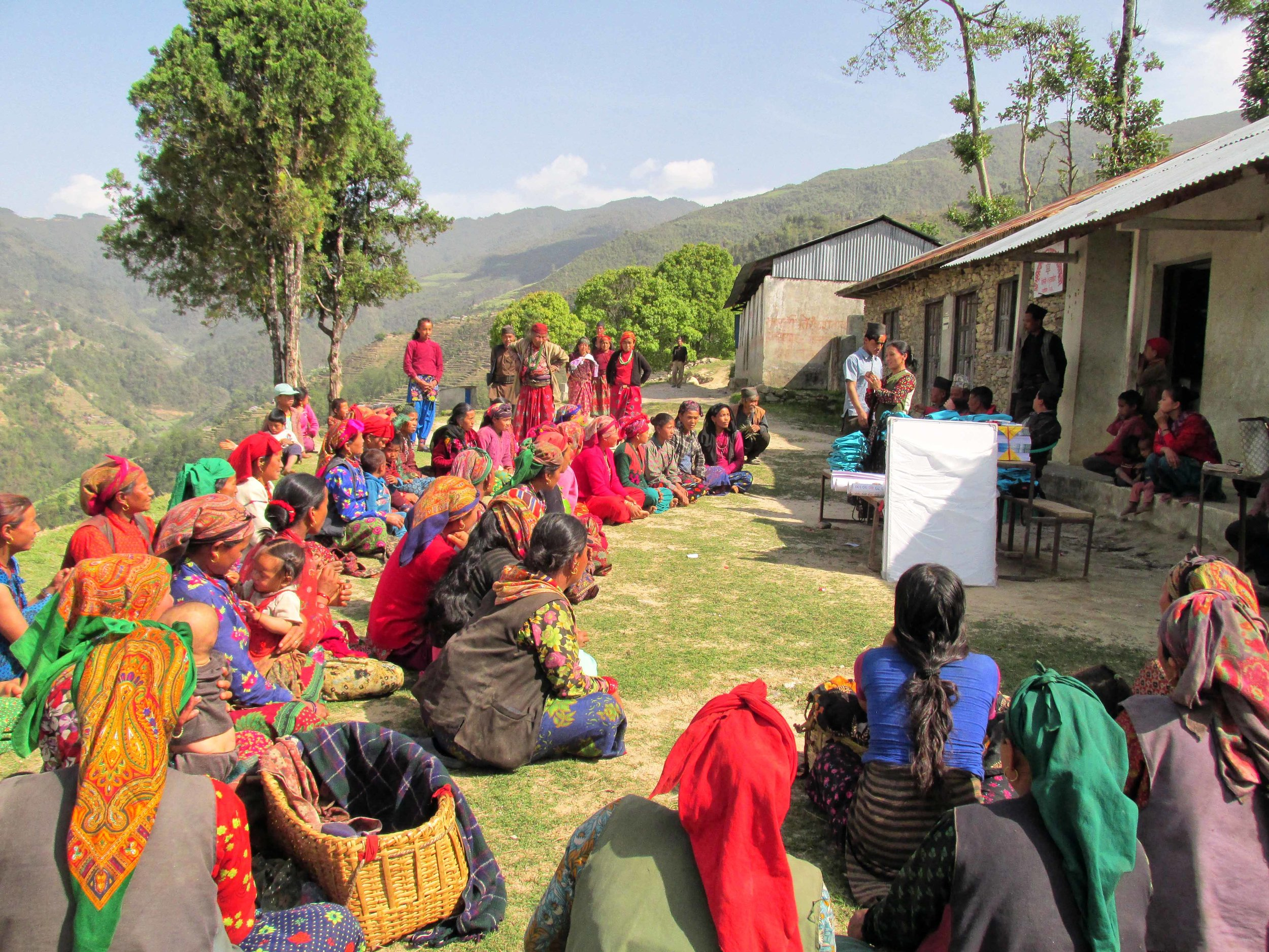 Women from Chipling Village enjoying their literacy class with a view
