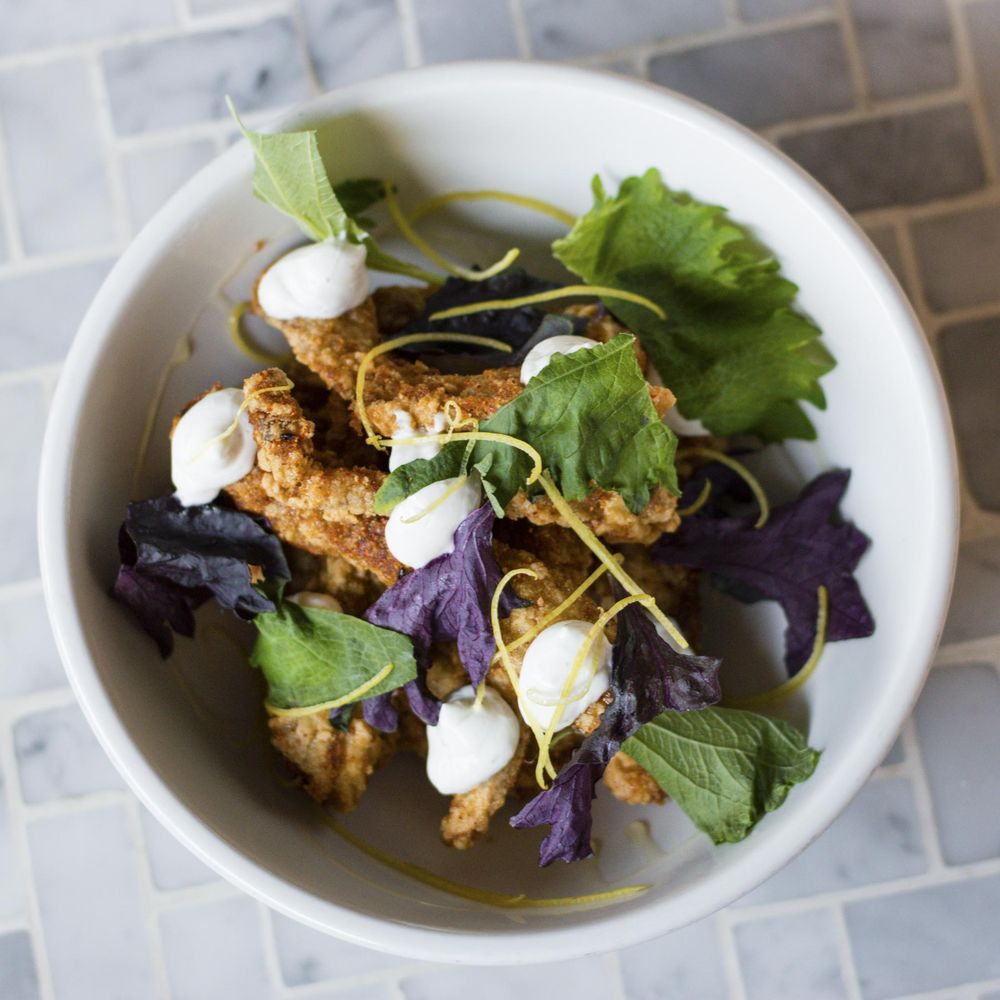 Shichimi togarashi fried eggplant is plated with with lime, yogurt, and shiso leaf at Rider in Brooklyn.  Source: Rider