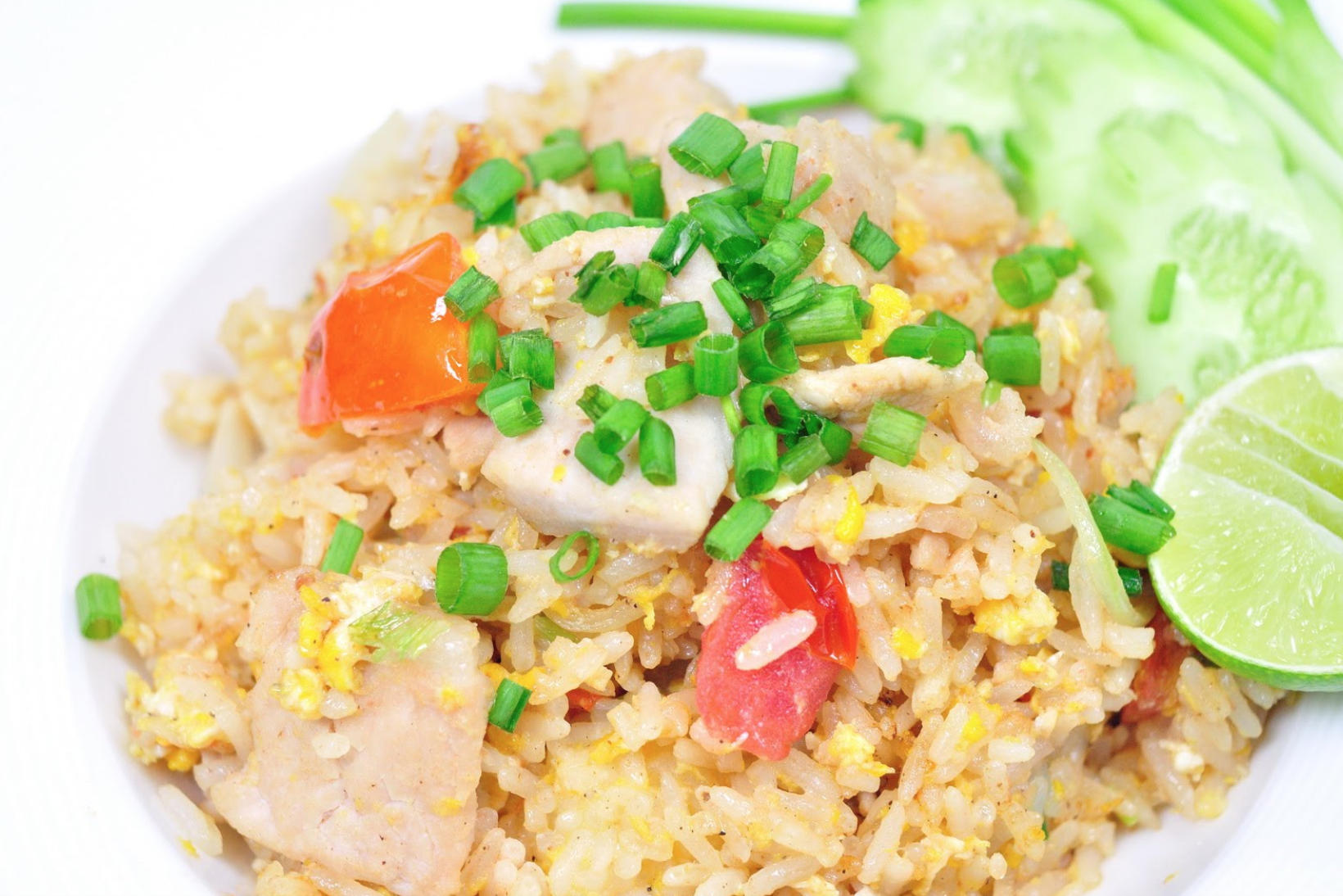Fried Rice with chicken or tofu - $10   Ingredients: Jasmine rice stir fried with egg, soy sauce, carrots, green beans, corn, peas, green onions, white onions, and a dash of pepper on top.