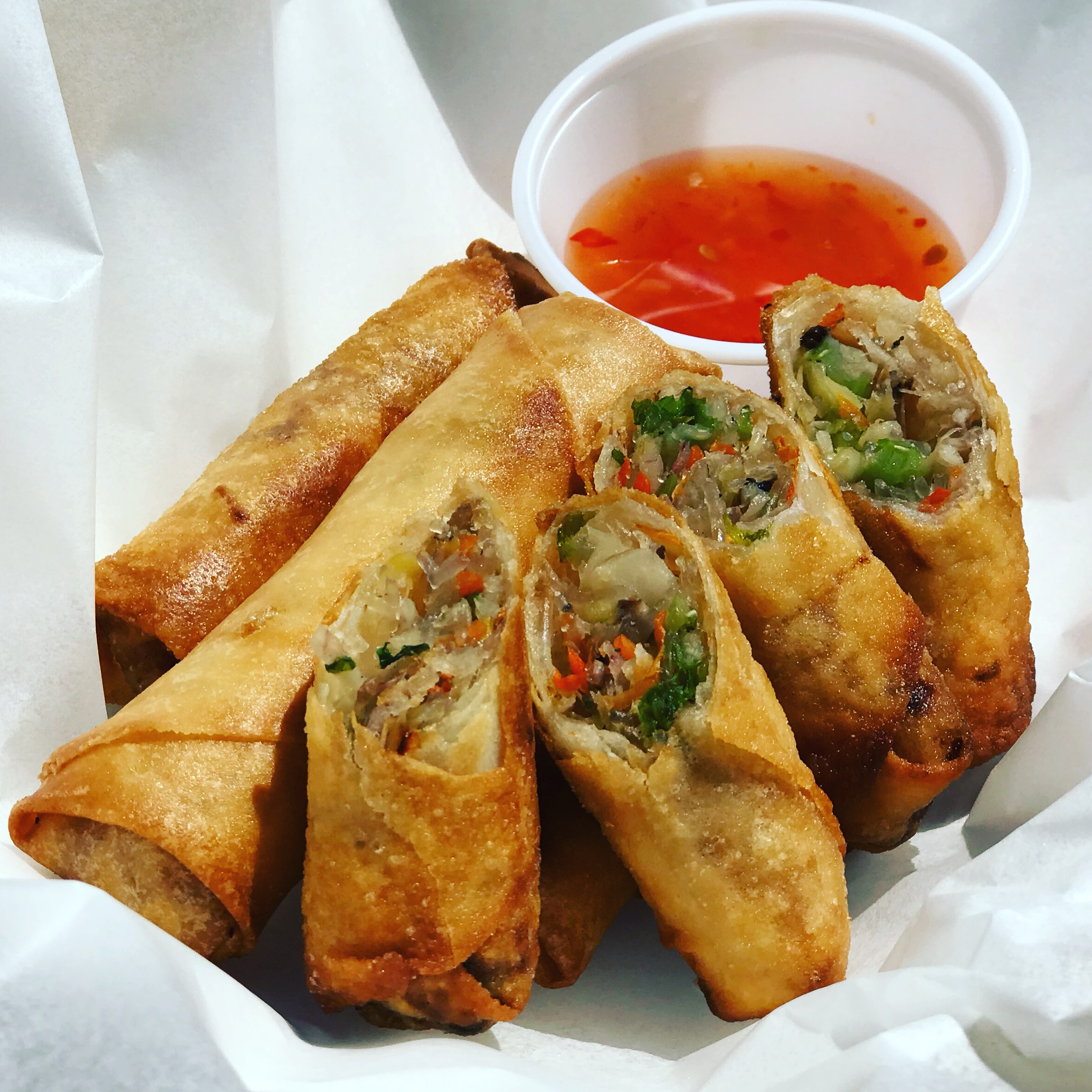 Vegetable Spring Rolls with Sweet & Sour Sauce - 4 for $4 (or 1 for $1.25)  Ingredients: chopped Taro, cabbage, carrots, clear noodles wrapped in a crispy wonton wrap.