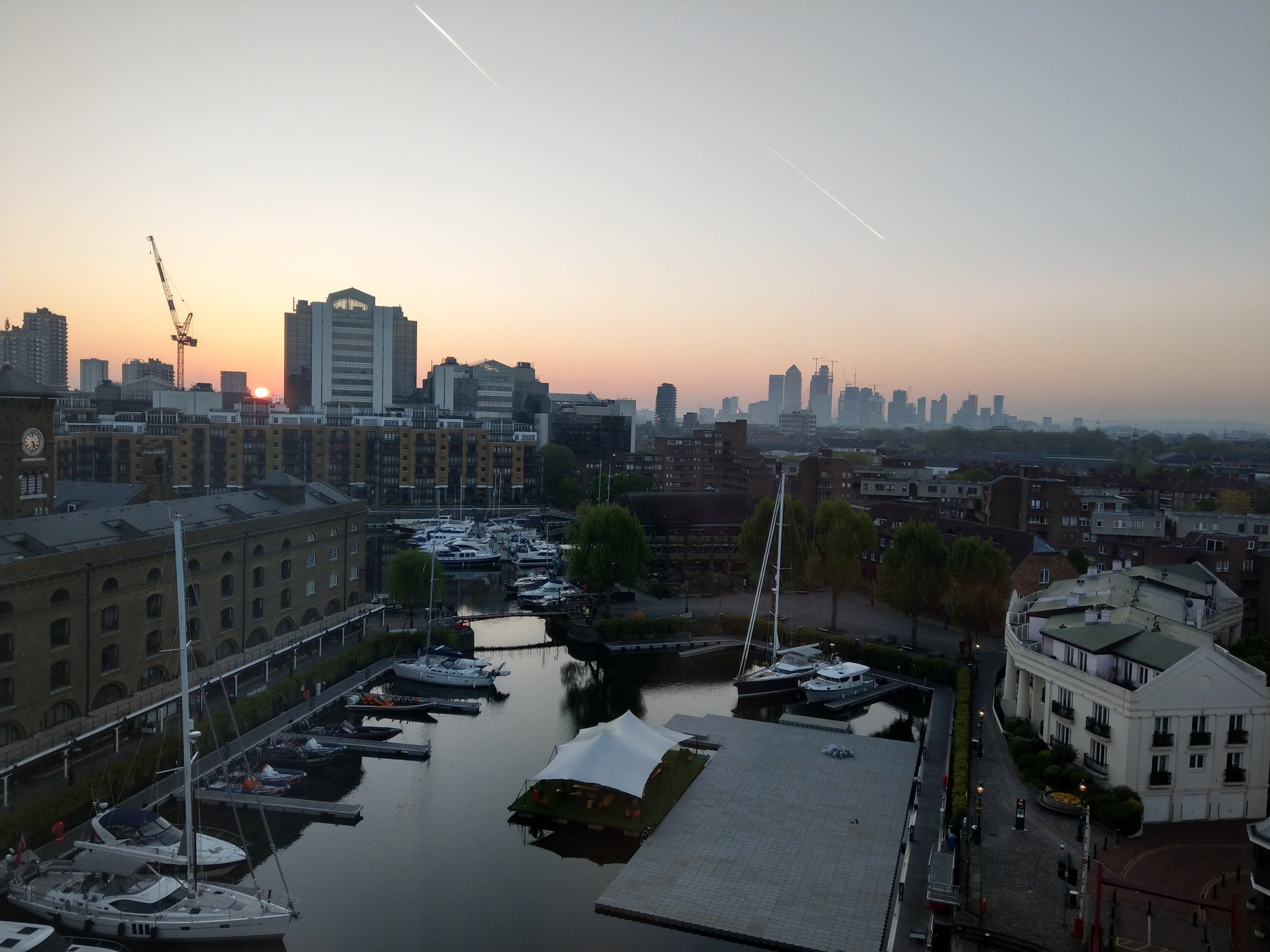 From St. Katharine Docks in London, looking out at Canary Wharf at sunrise
