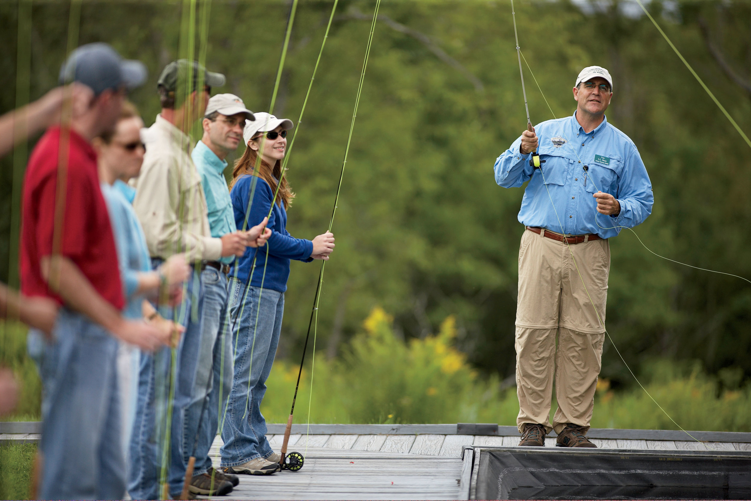 Students learning the fundamentals of fly casting