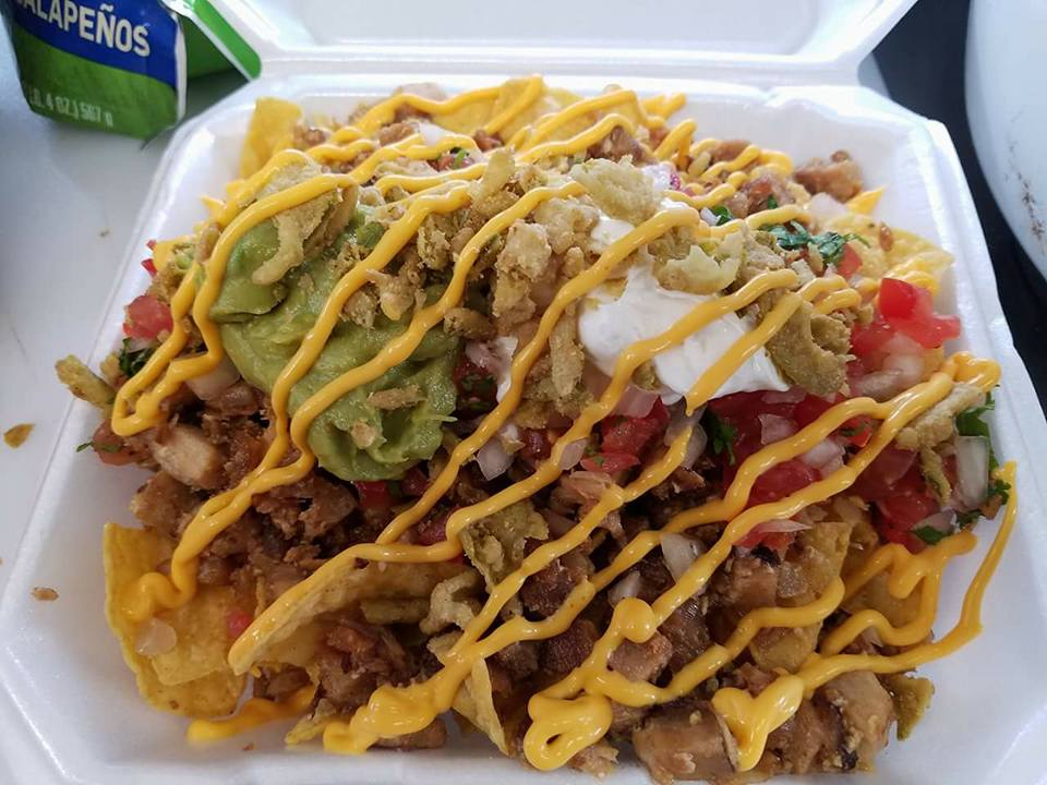 Jeepney by Adobo Grill's famous  sisig nachos. ( Photo courtesy of Jeepney by Adobo Grill)