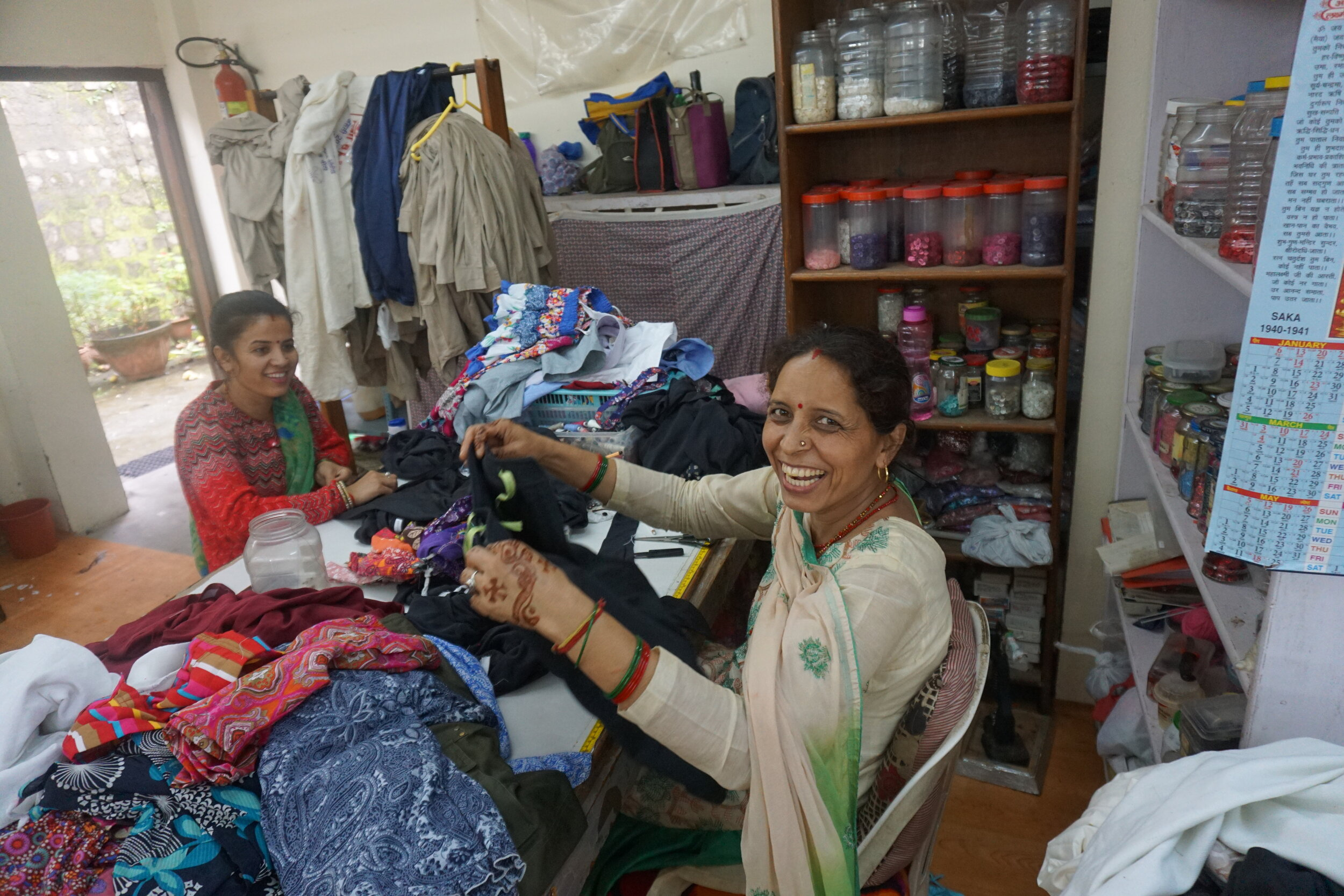 Sushma and Sheetal laughed at me for taking so many pictures while they stitched the tags onto a pair of SheFly pants.
