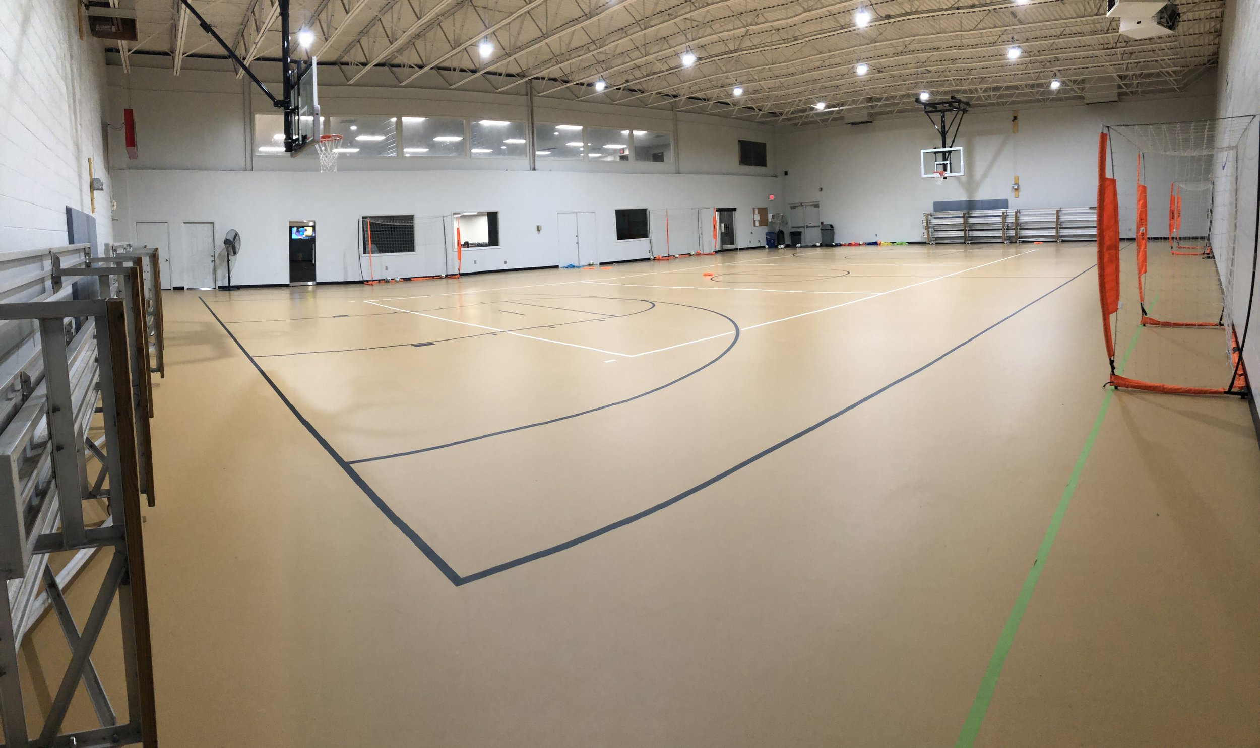 Charlotte Futsal Center of Excellence - 1200 S Caldwell St, Charlotte, NC 28203-Furnished lounge with recreational activities and TV-second floor viewing area-observation windows in lounge-wifi
