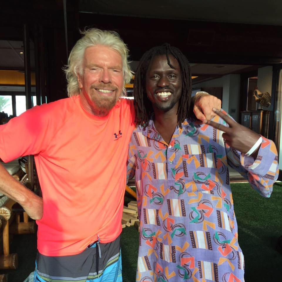 Emmanuel Jal with Richard Branson at the Virgin Unite conference on Necker Island.