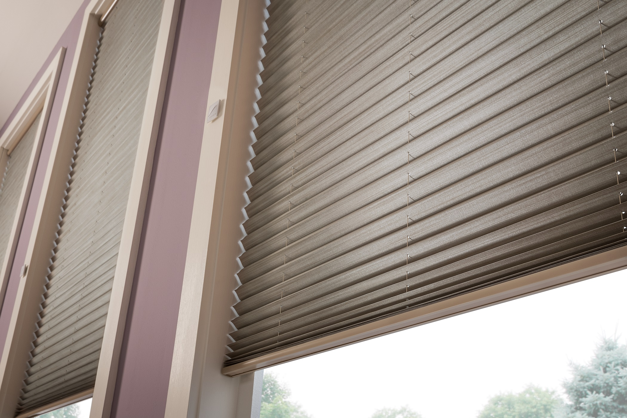 Pleated Shades feature the most up-to-date textiles from a broad spectrum of colors, patterns, and textures, all folded into crisp pleats. It's a sophisticated and modern look that also filters the light and extends privacy protection to your home.