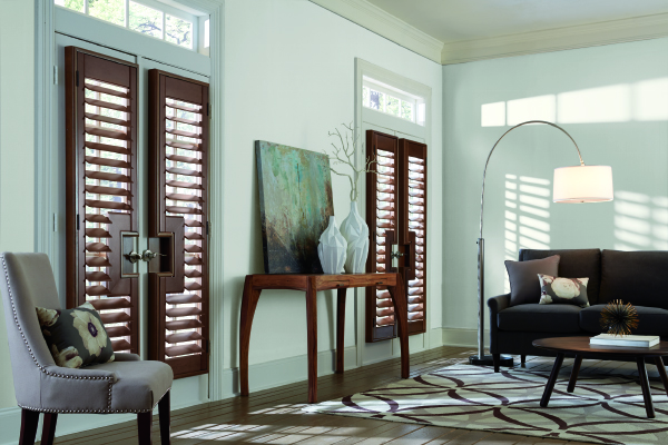 Real wood shutters are the ideal product to add equity to your home.   Our wood shutters are made exclusively from North American hardwoods.  Shutters can be designed to fit custom shapes, arch or angle top panels, and sunburst arches. French doors with curved or rectangular cut-outs for handles are also available. Plus, shutters can be specially configured for bay and corner windows. Wood shutters can be enhanced with an assortment of paints, stains, options, and upgrades.