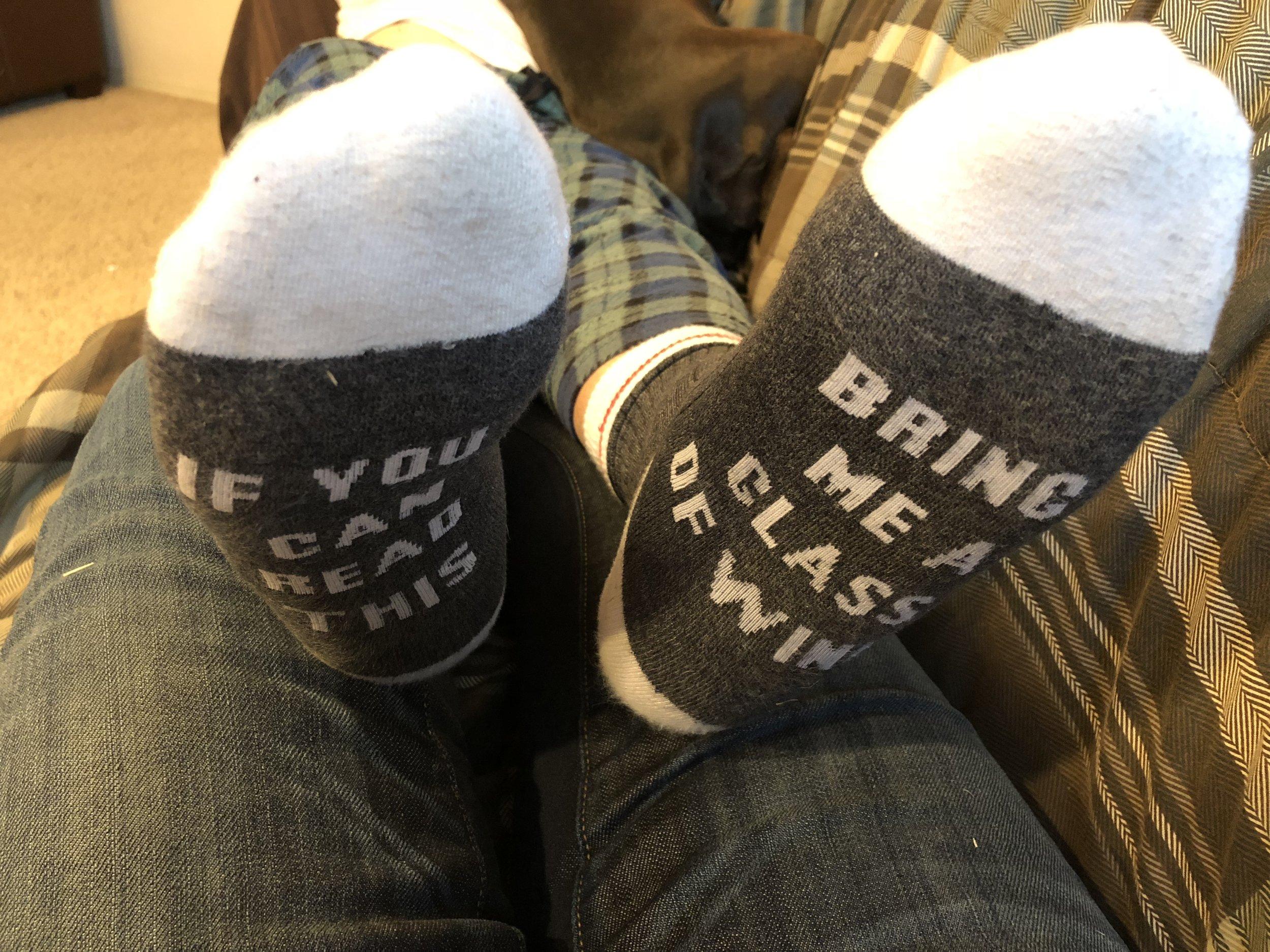 MY socks on my husband's feet.