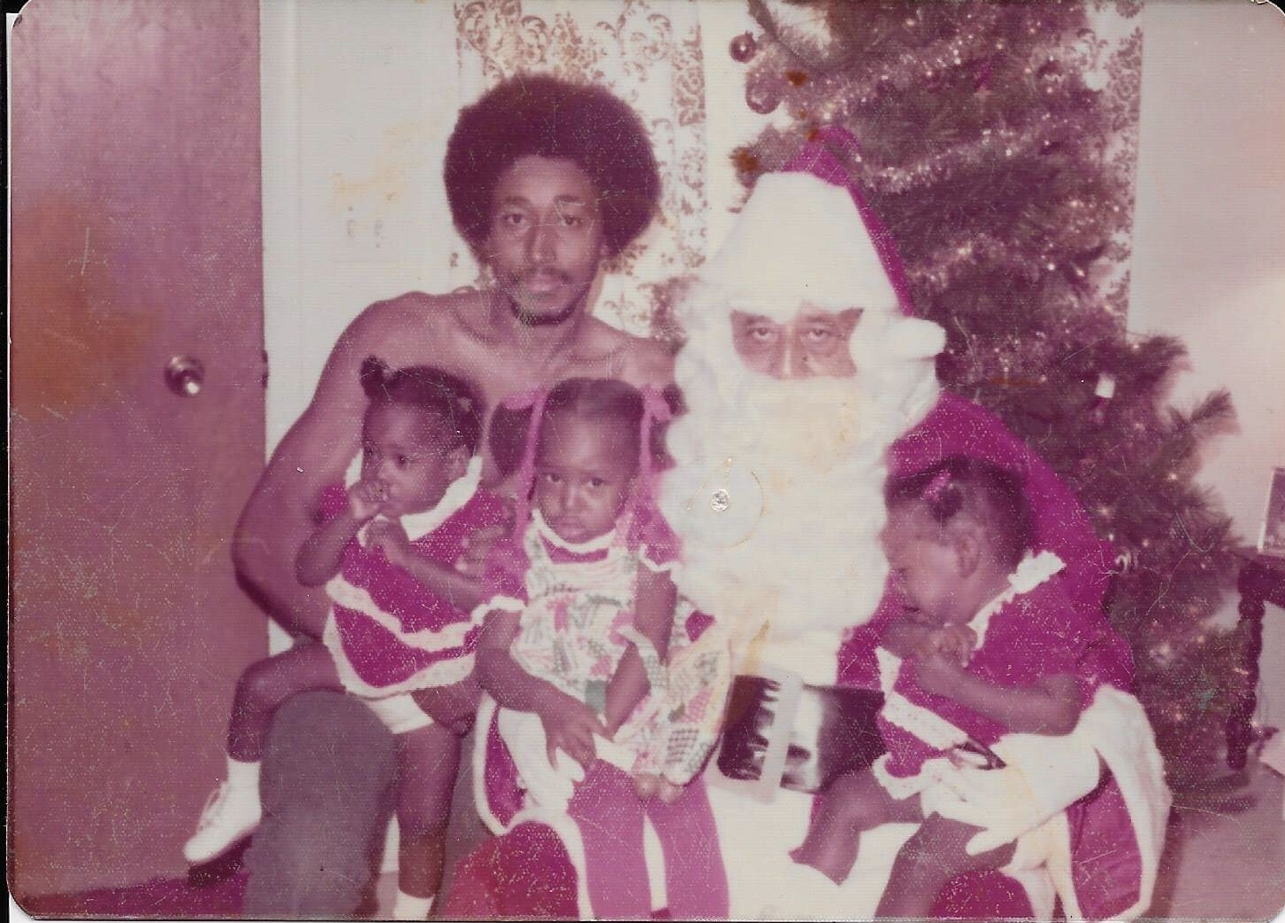 My Daddy, My twin sisters and I with Daddy Nate as Santa Clause.