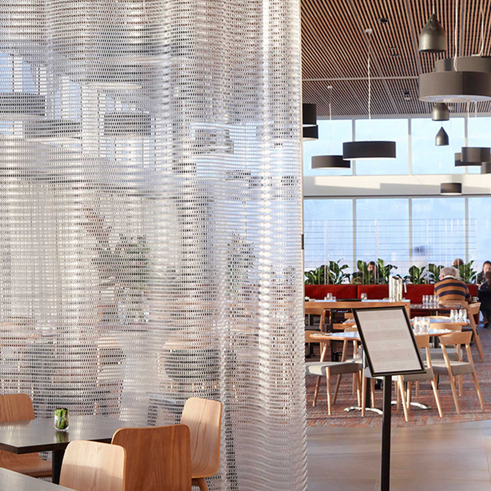 Folding Screens   Kaynemaile folding screens are an operable system ideal for creating functional separation and visual privacy while maintaining an open plan atmosphere.