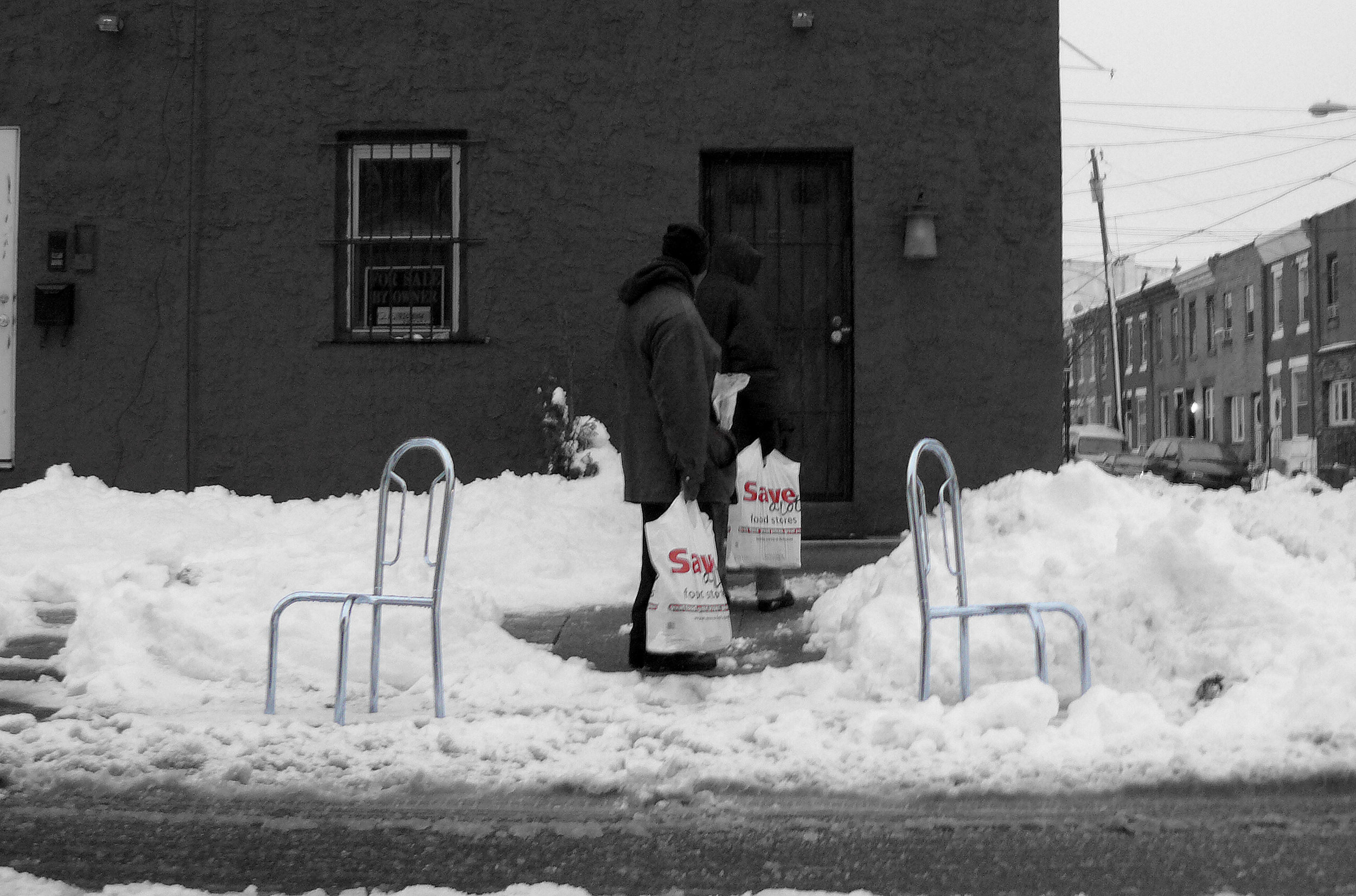 "sAVIES - After a particularly heavy snowstorm, the clean up begins. Parked vehicles on the street are are often plowed into their spots, thereby compounding shoveling out. Much effort is oftenindividually expended to release one's vehicle from its frozen prison. Therefore, once the spot is cleared, that spot is often believed by the shoveler to be personally ""owned"" until the snow on the street has melted away. Random furniture, concrete filled buckets and unwanted bric a brac are brought out to ""save"" the spot. Signs are often posted with threatening, expletive-laden scrawl. Fights have broken out over these cleared spots, and in Boston last year a man was shot. Evidently, clearing a spot altruistically, for any neighbor to benefit, is not something taught in Sunday school. Instead, marking one's temporary territory by calling ""Savesies"" is the lesson learned.Click on the image for more"