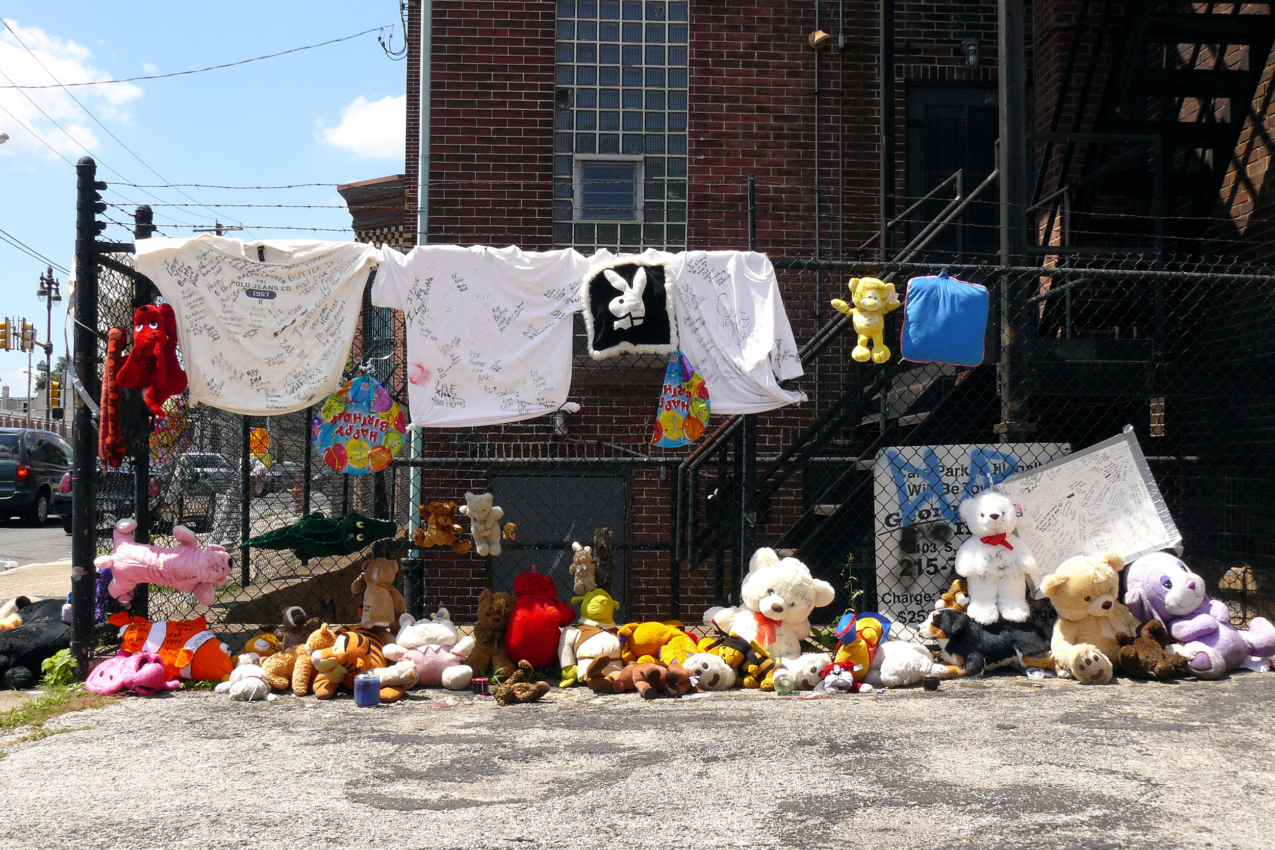 Urban Memorials - These images were all taken on the streets of Philadelphia. The objects brought and the emergent nature of display at an impromptu memorial site, are by-products of our culture. Here, people have been taken before their time. What do you bring for a child that has been gunned down? How does one express their grief and sorrow for a friend or neighbor? Who cleans the site up and when? Where does it all go? When will it stop?Click on the image for more